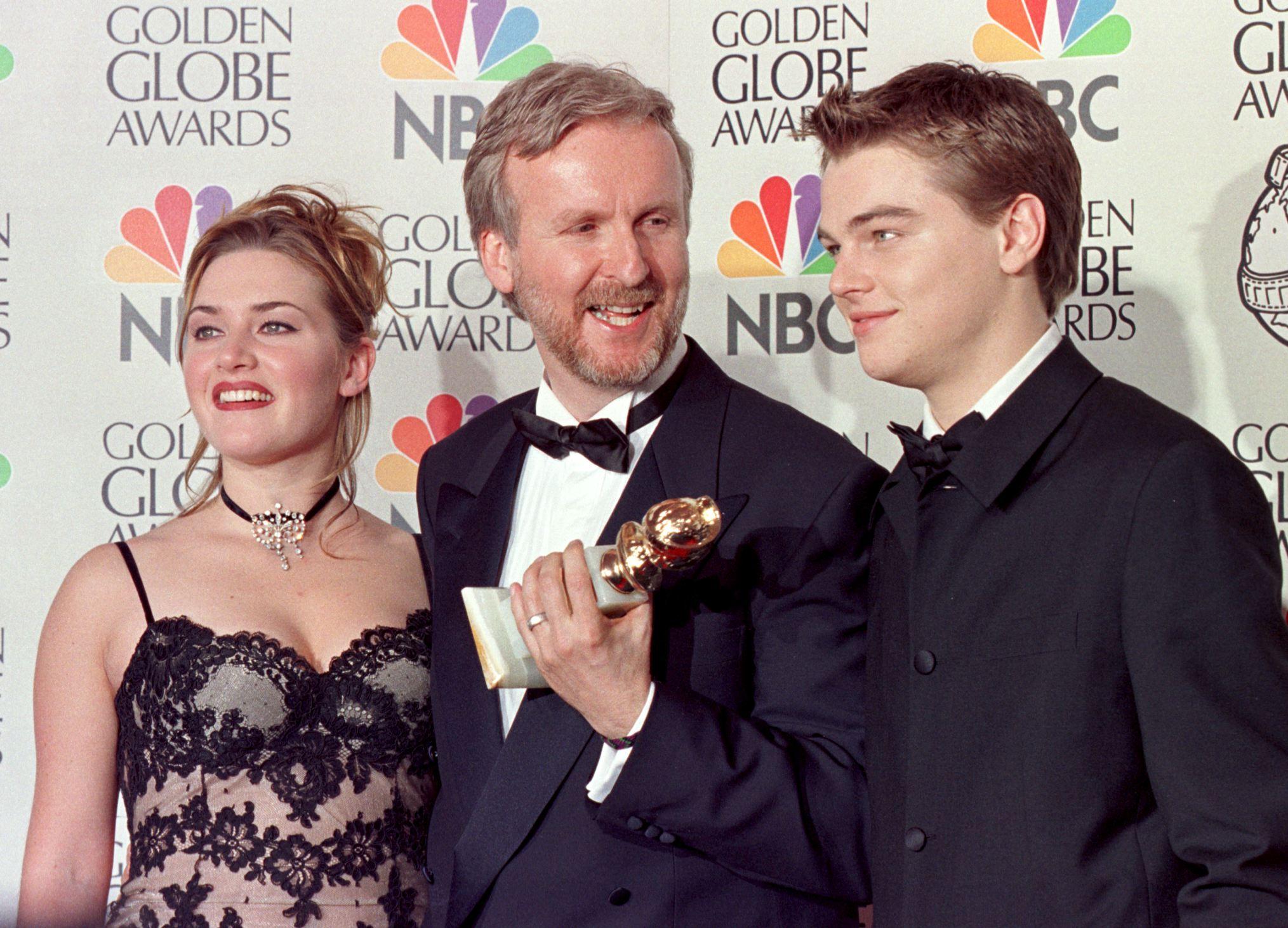 Director James Cameron(C) and actress Kate Winslet