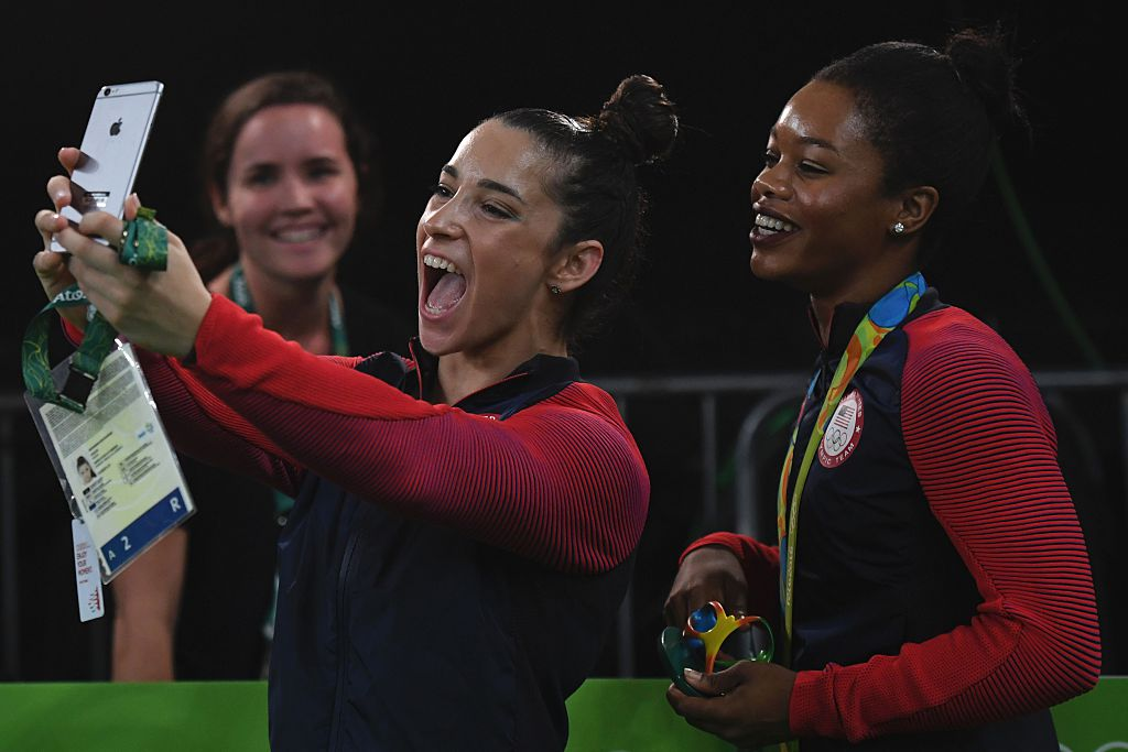 Aly Raisman and Gabby Douglas pose for selfie together at 2016 Olympics