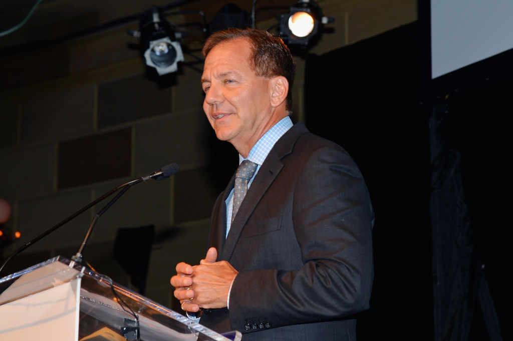 Paul Tudor Jones speaking at a podium.
