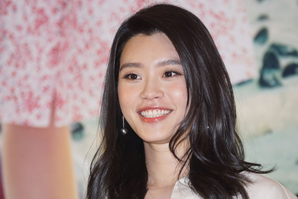 Chinese model Ming Xi smiles for the camera.
