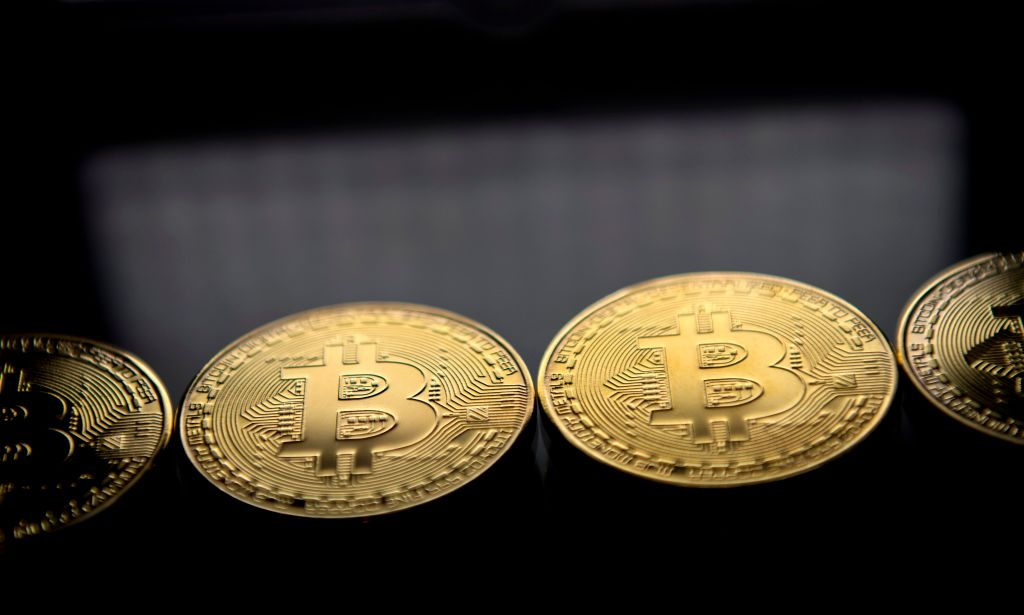 Bitcoins on a black background.