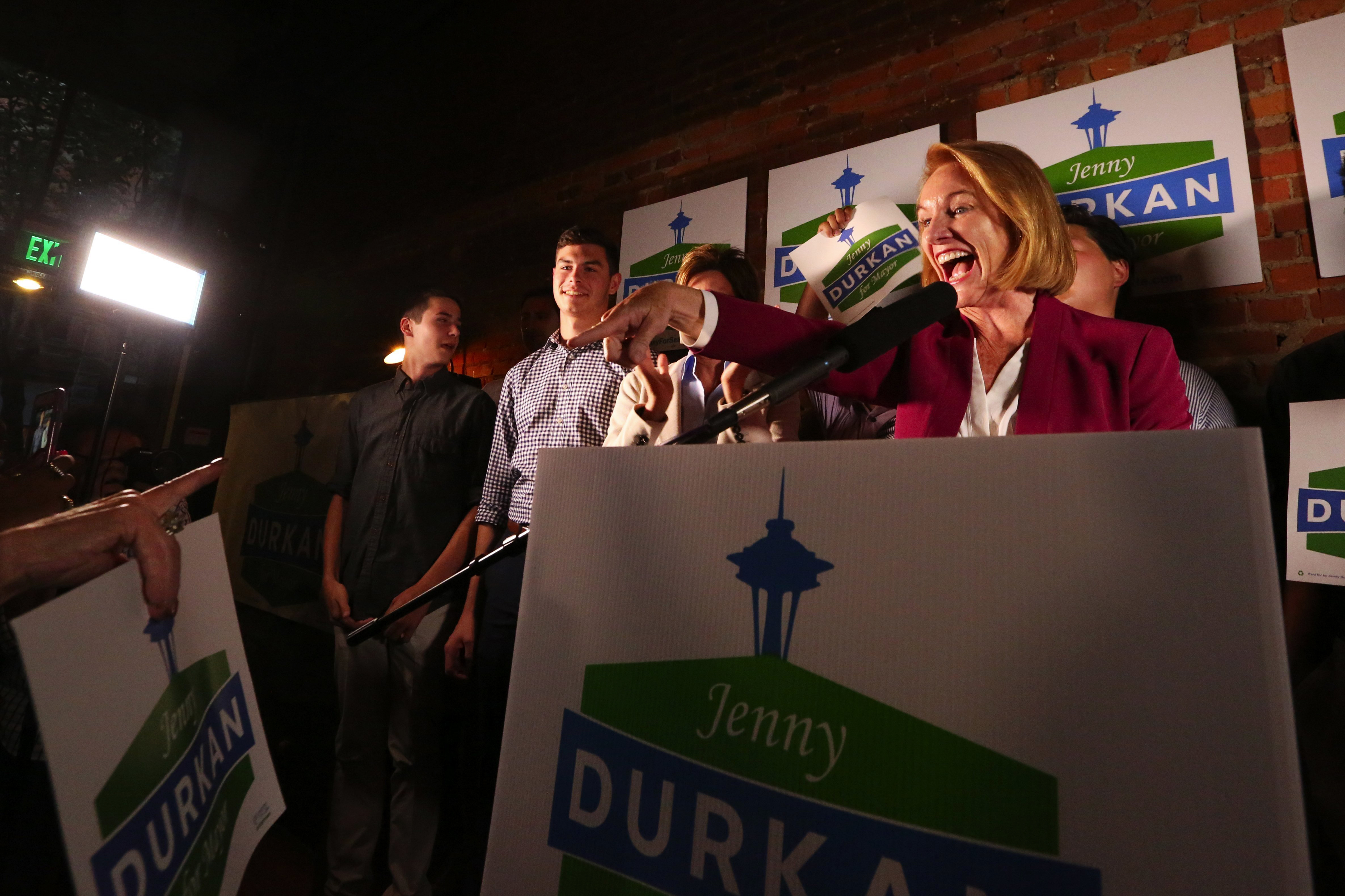 Seattle Mayoral candidate Jenny Durakn speaks at a podium at a political rally.