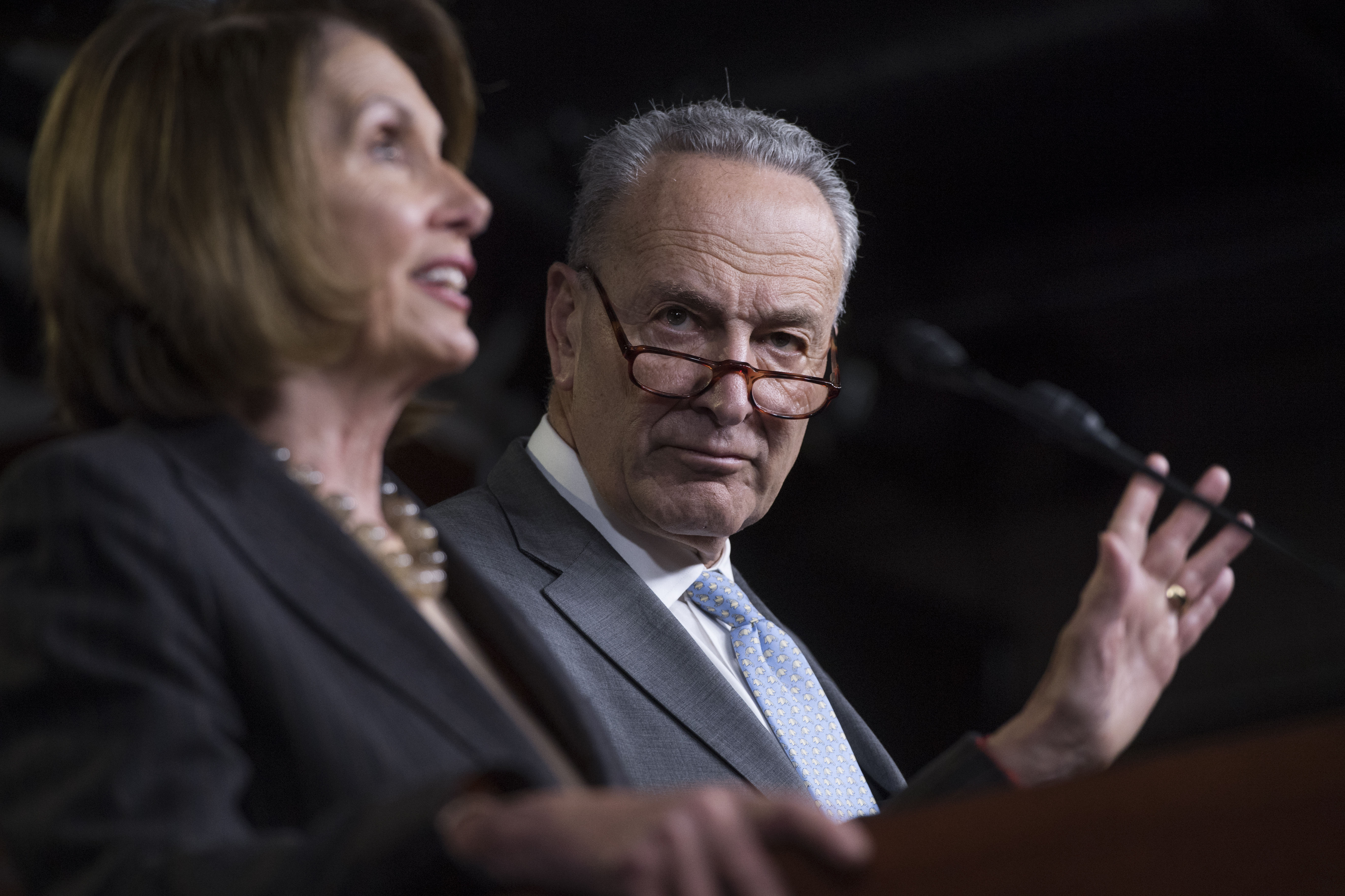 Nancy Pelosi and Chuck Schumer speaking at a press conference