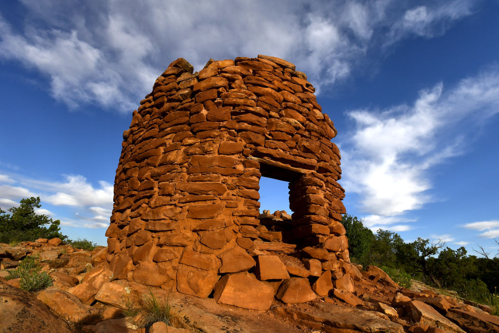 The orange stones of Pueblo ruins in Bears Ears National Monument, Utah, appear against a blue sky