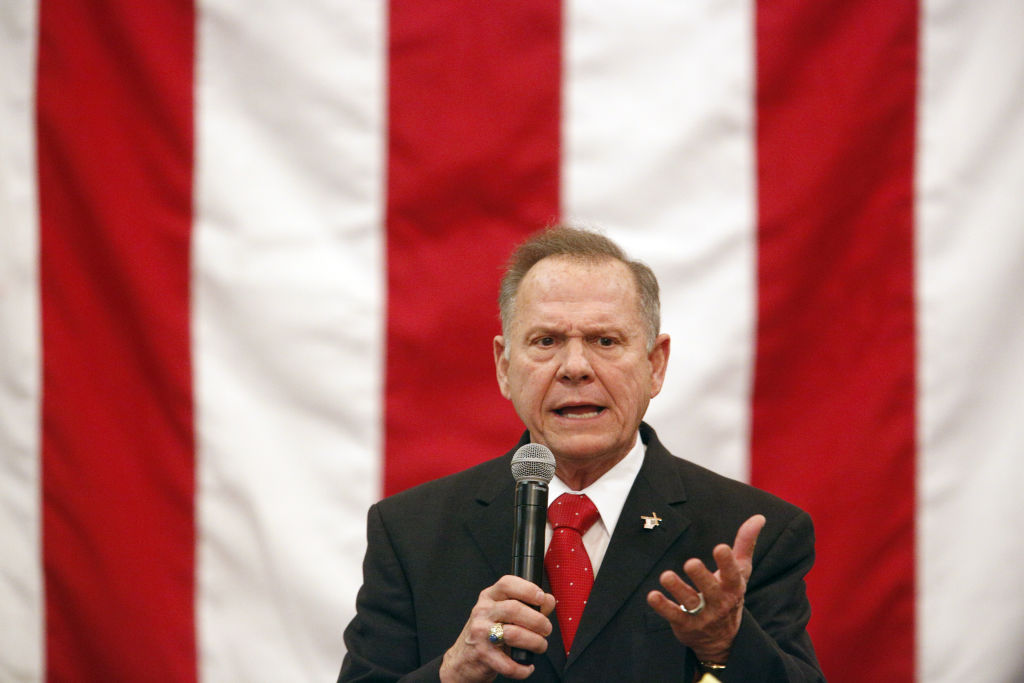 Republican Senate Candidate Roy Moore appears before American flag at campaign rally