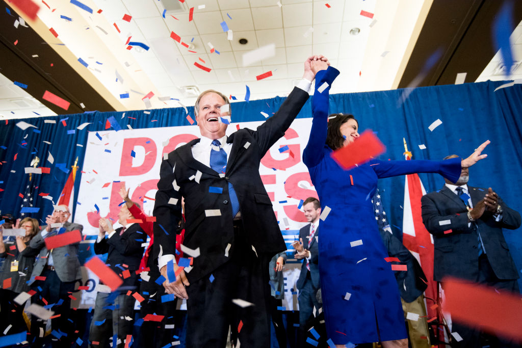 Alabama Democrat Senator-elect Doug Jones celebrates his victory, holding hands with wife Louise at victory party as confetti rains