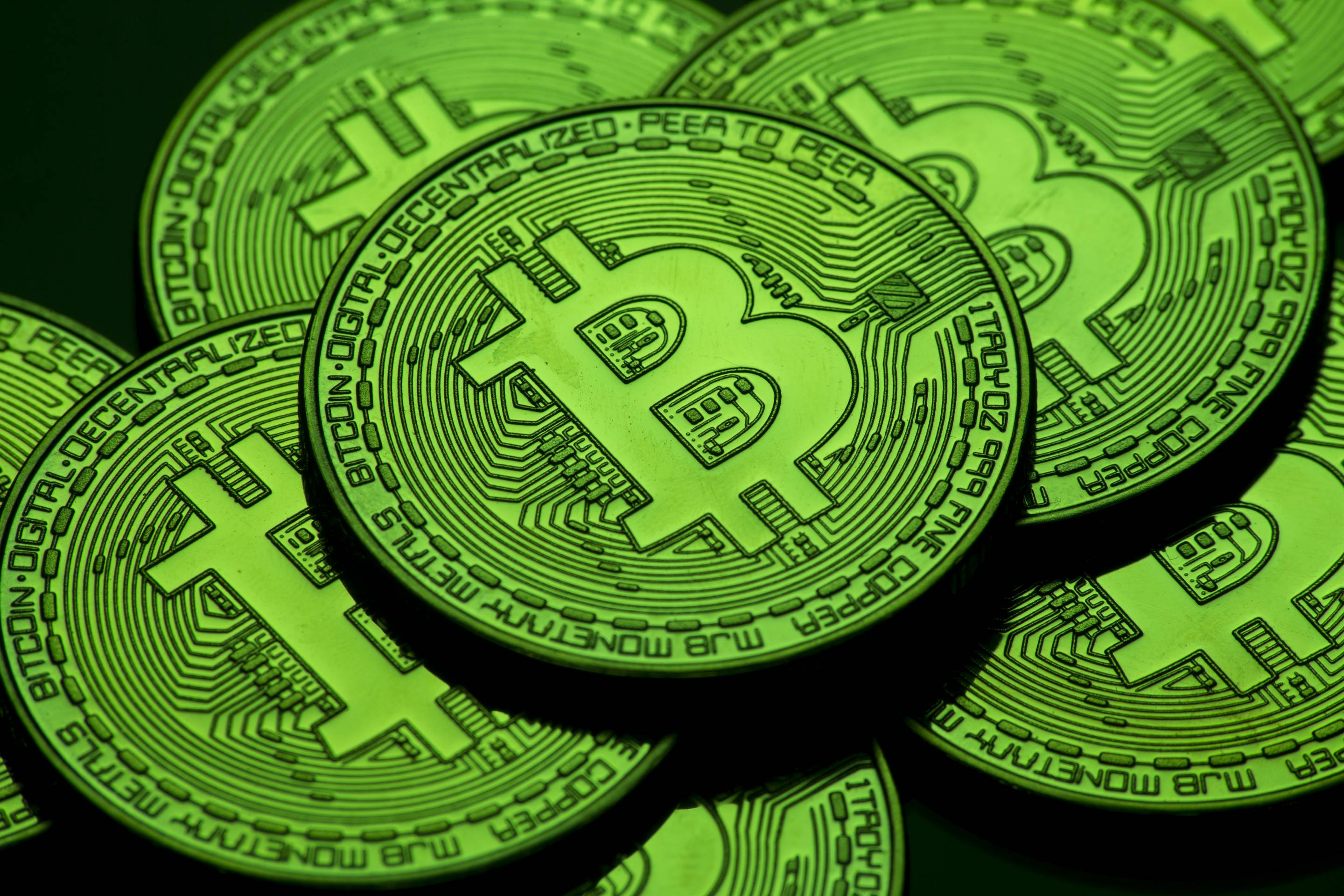 A green visual representation of the cryptocurrency Bitcoin.