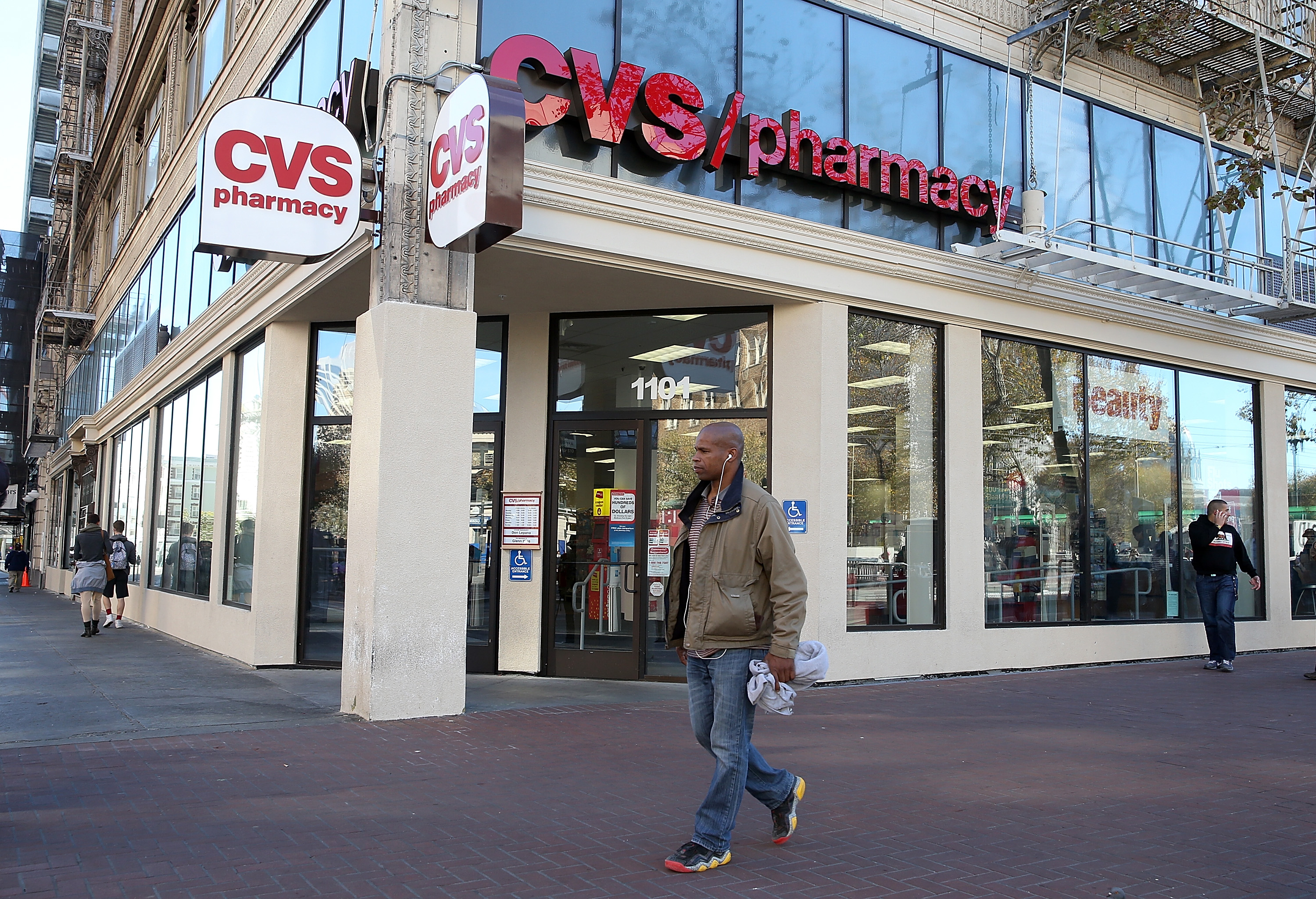 Pedestrians walk by a CVS store on November 5, 2013 in San Francisco, California.