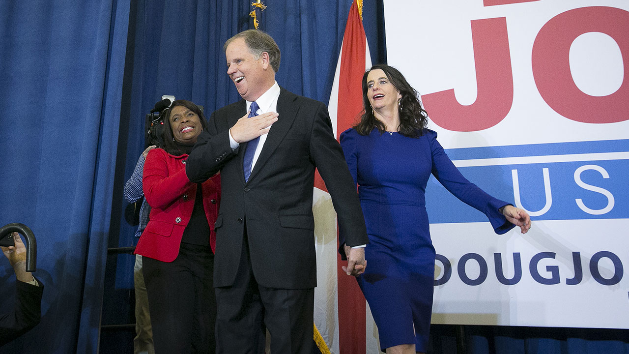 Senator-elect Doug Jones, a Democrat from Alabama, center, and wife Louise Jones, right, greet the audience at an election night party in Birmingham, Alabama  on Dec. 12, 2017.