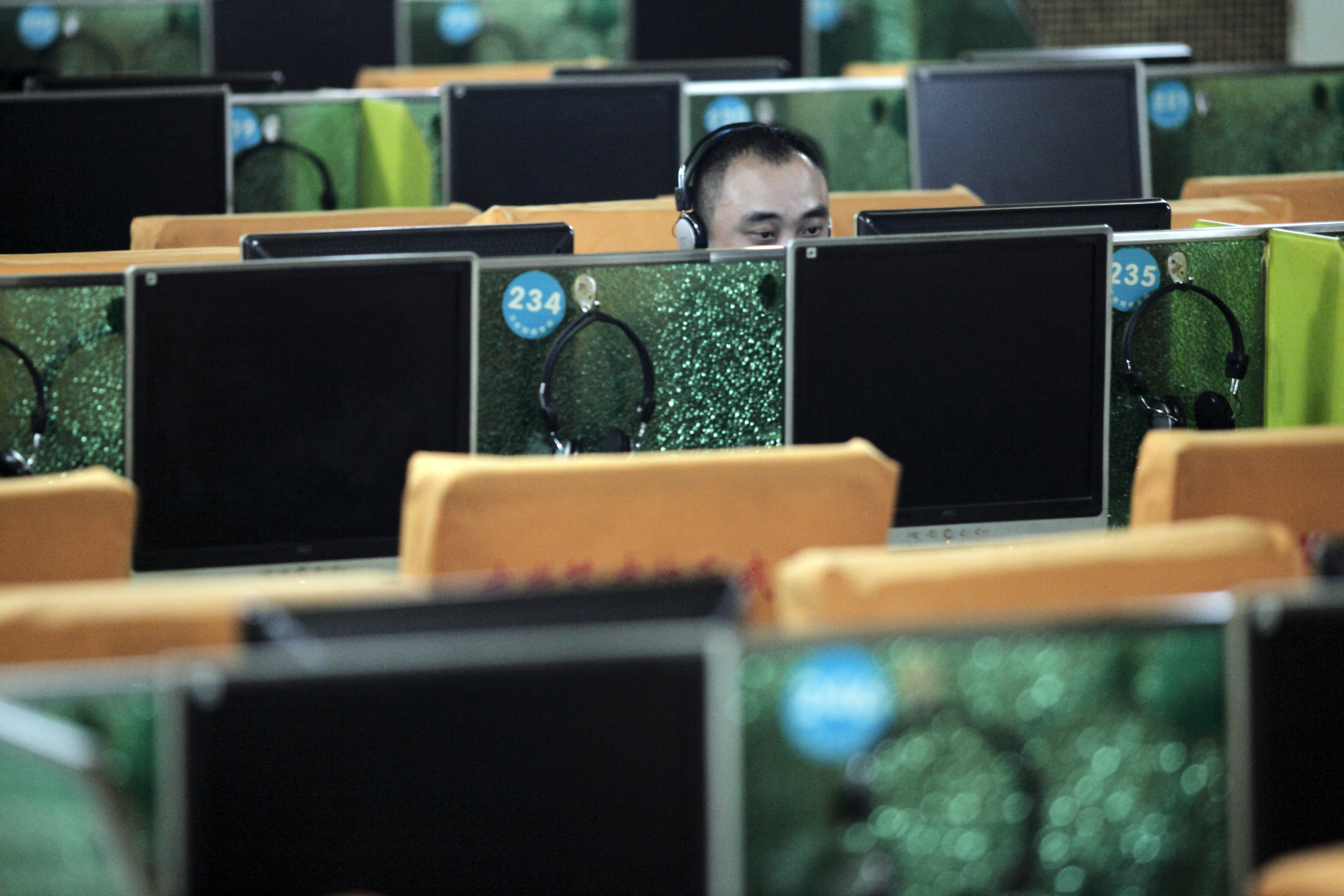 China - Technology - Customers use computers at an internet cafe in Shanghai