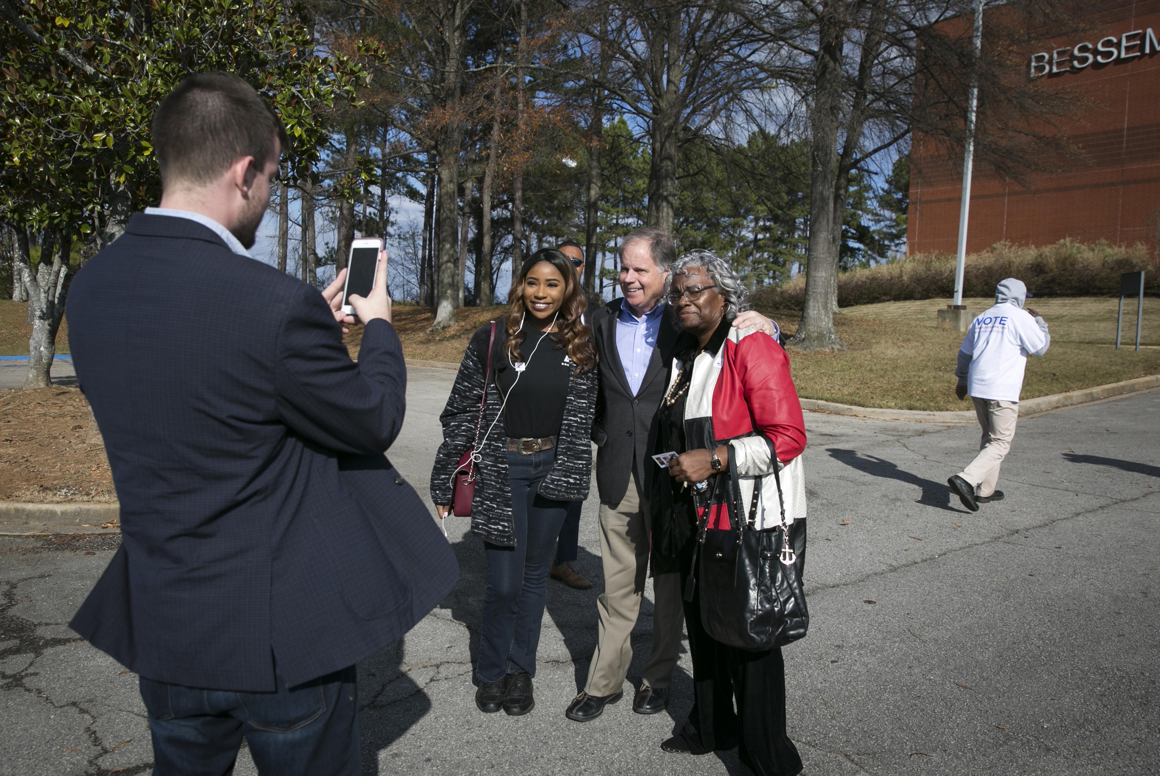 Alabama Democratic Senate Candidate Doug Jones Greets Voters Outside A Polling Location