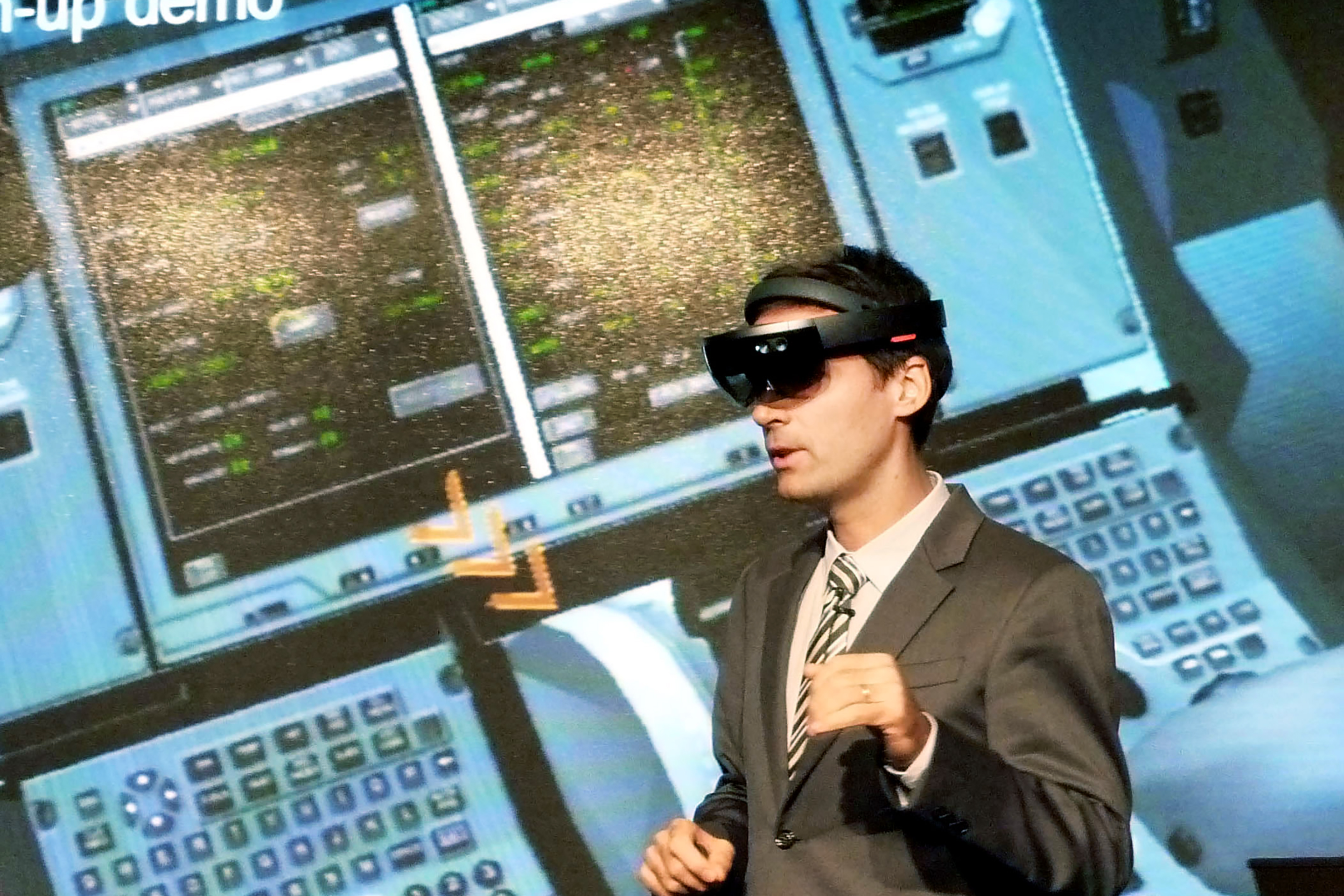 An Airbus staffer views a cockpit with VR.