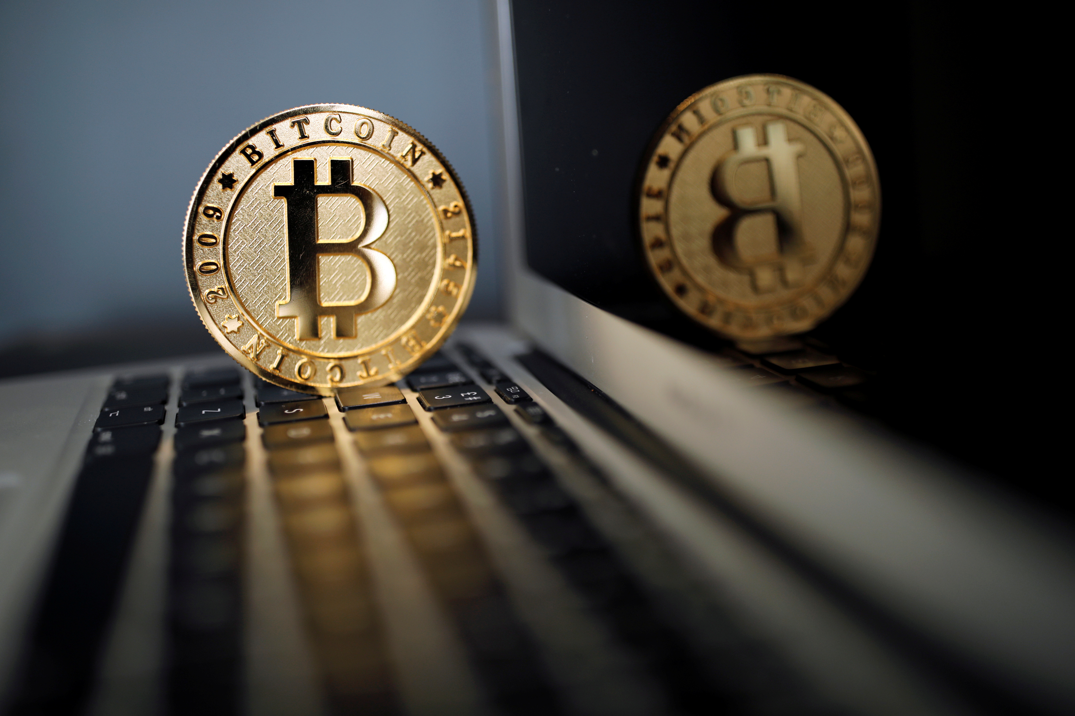 A Bitcoin (virtual currency) coin is seen in an illustration picture taken at La Maison du Bitcoin in Paris