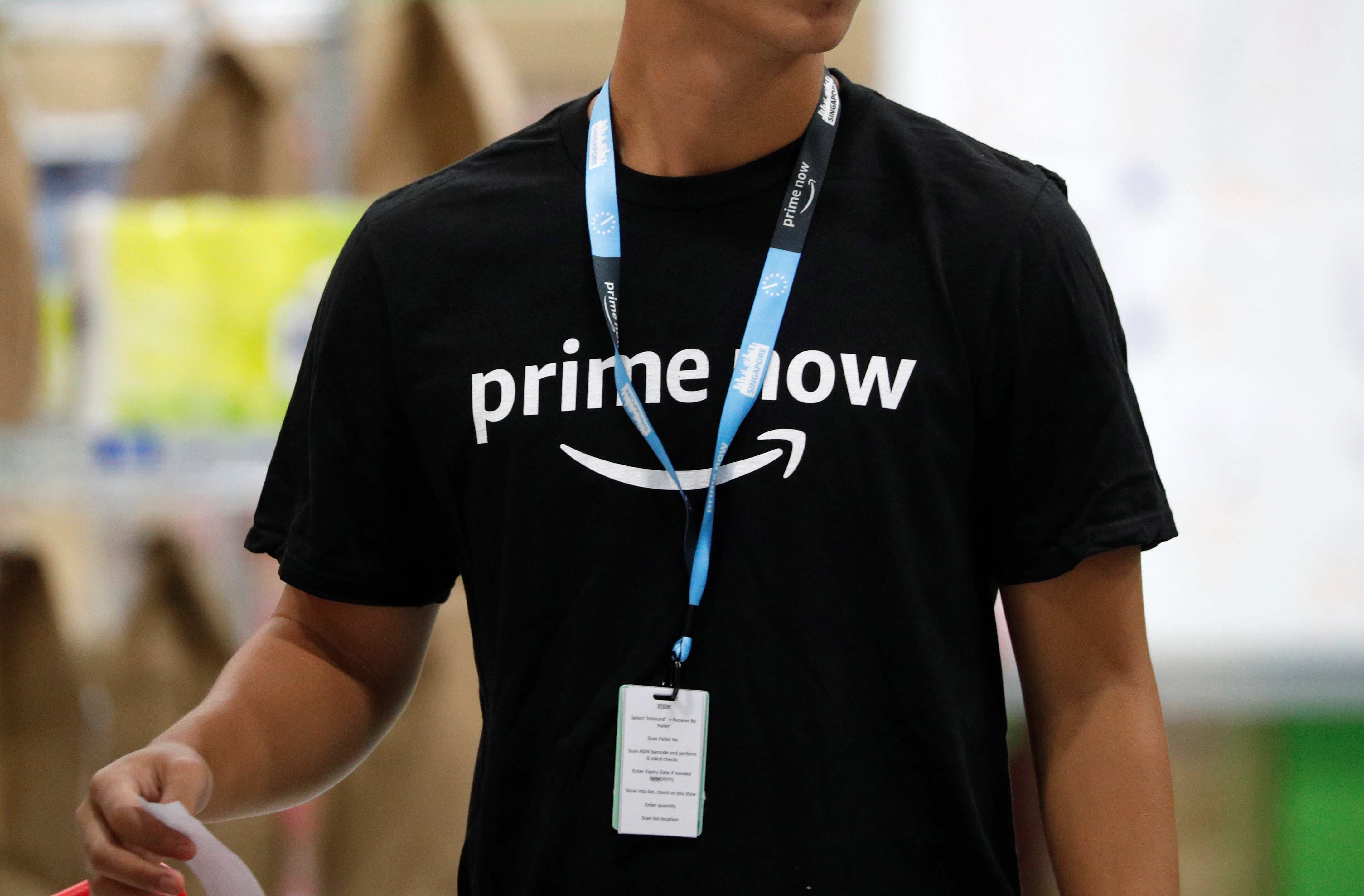 An employee works at Amazon's Prime Now fulfillment centre in Singapore
