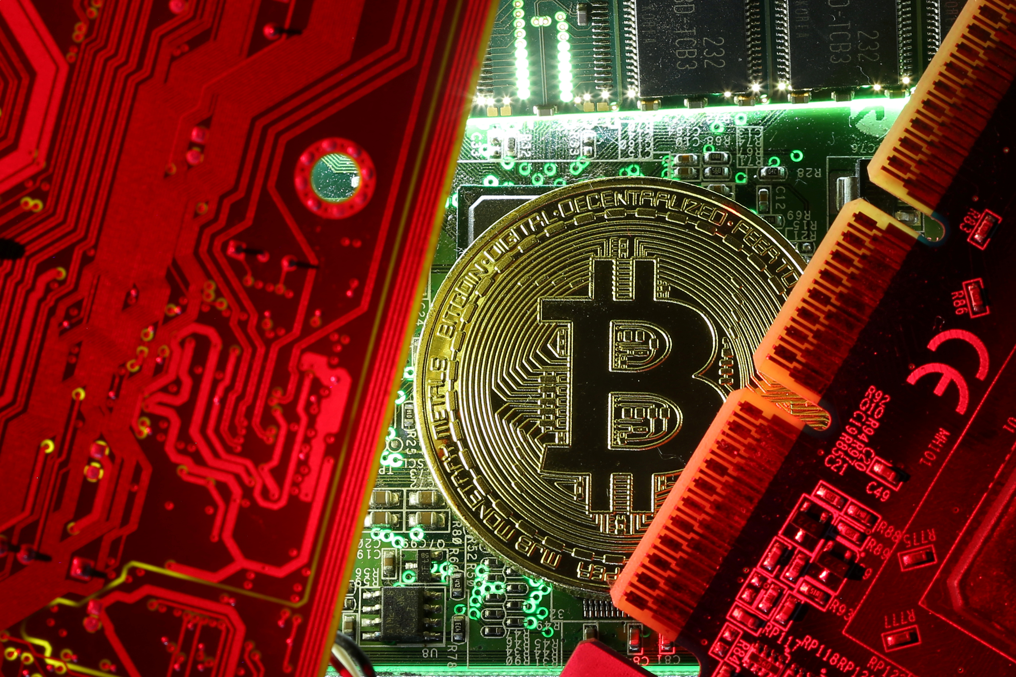 FILE PHOTO: A coin representing the bitcoin cryptocurrency is seen on computer circuit boards in this illustration picture