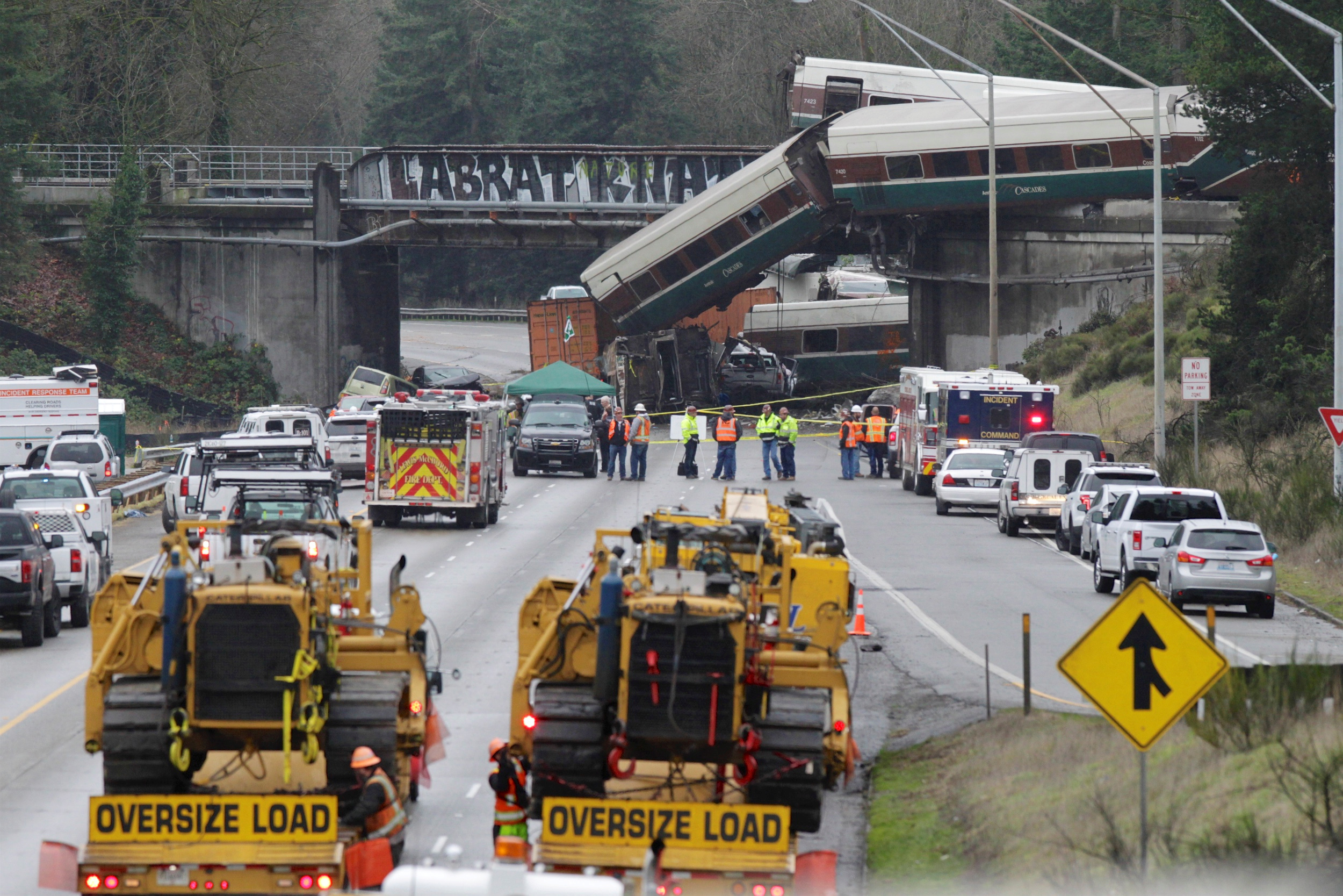 FILE PHOTO: Rescue personnel and equipment are seen at the scene where an Amtrak passenger train derailed in DuPont