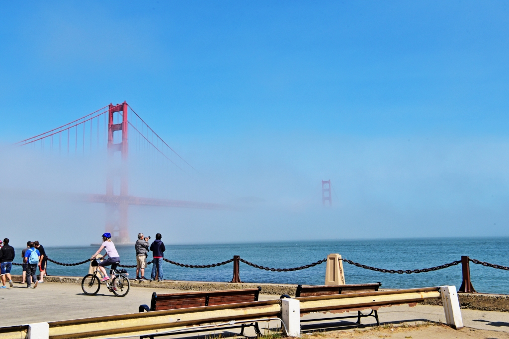People At Promenade Against Golden Gate Bridge During Foggy Weather