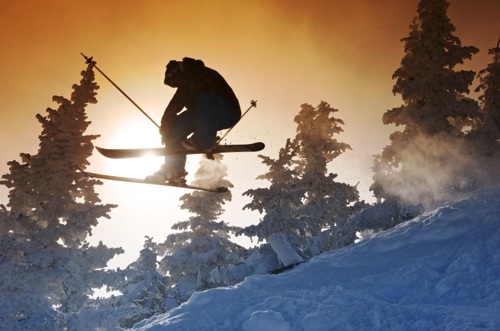 Airbourne skier at sunset at Jay Peak Ski Resort.