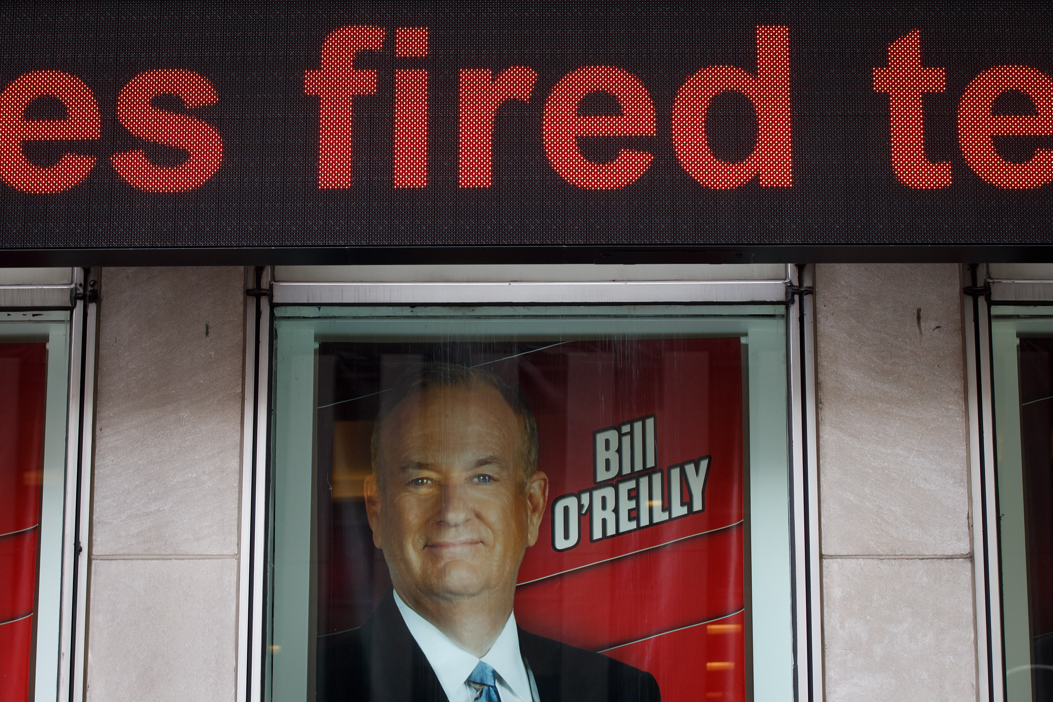 Advertisements for Fox News and Bill O'Reilly stand in a window outside of the News Corp. and Fox News headquarters in Midtown Manhattan, April 19, 2017 in New York City.