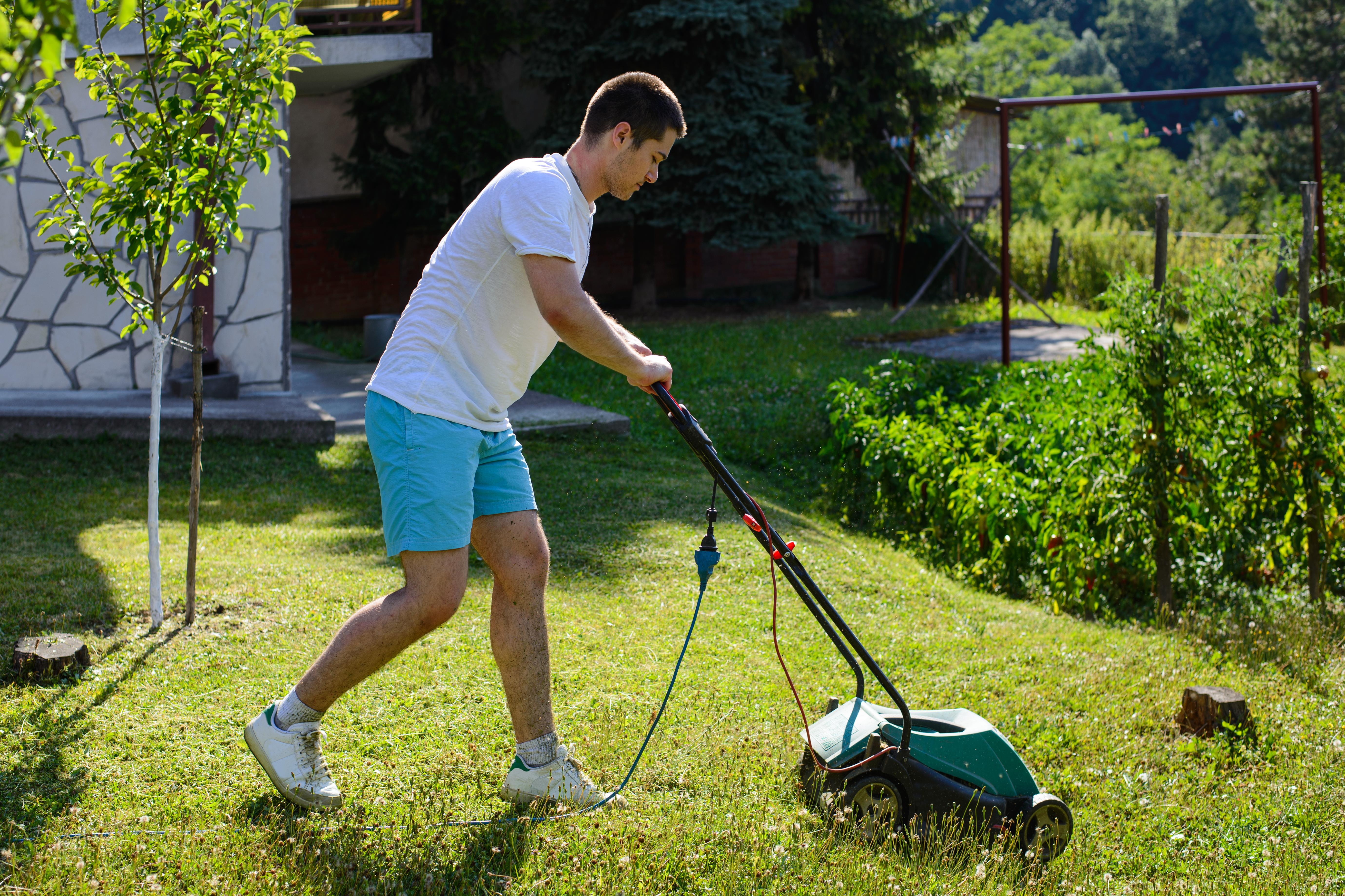 Teen Mowing Lawn