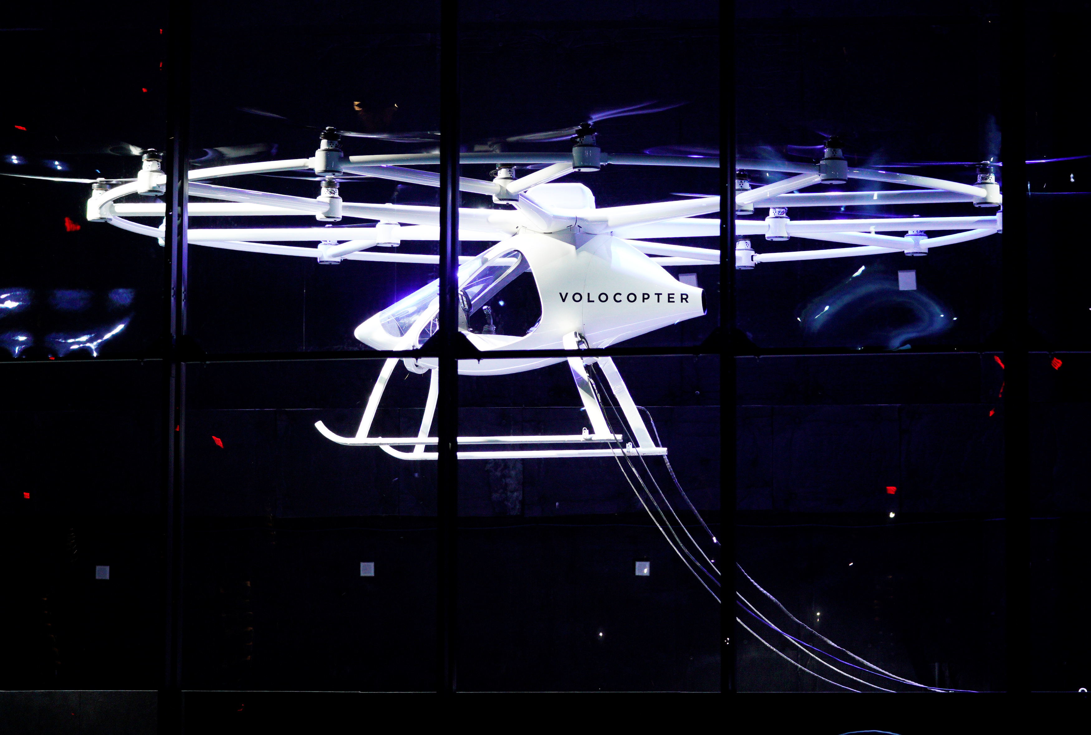 A two-seater Volocopter drone flies on stage at the Intel Keynote address at CES in Las Vegas