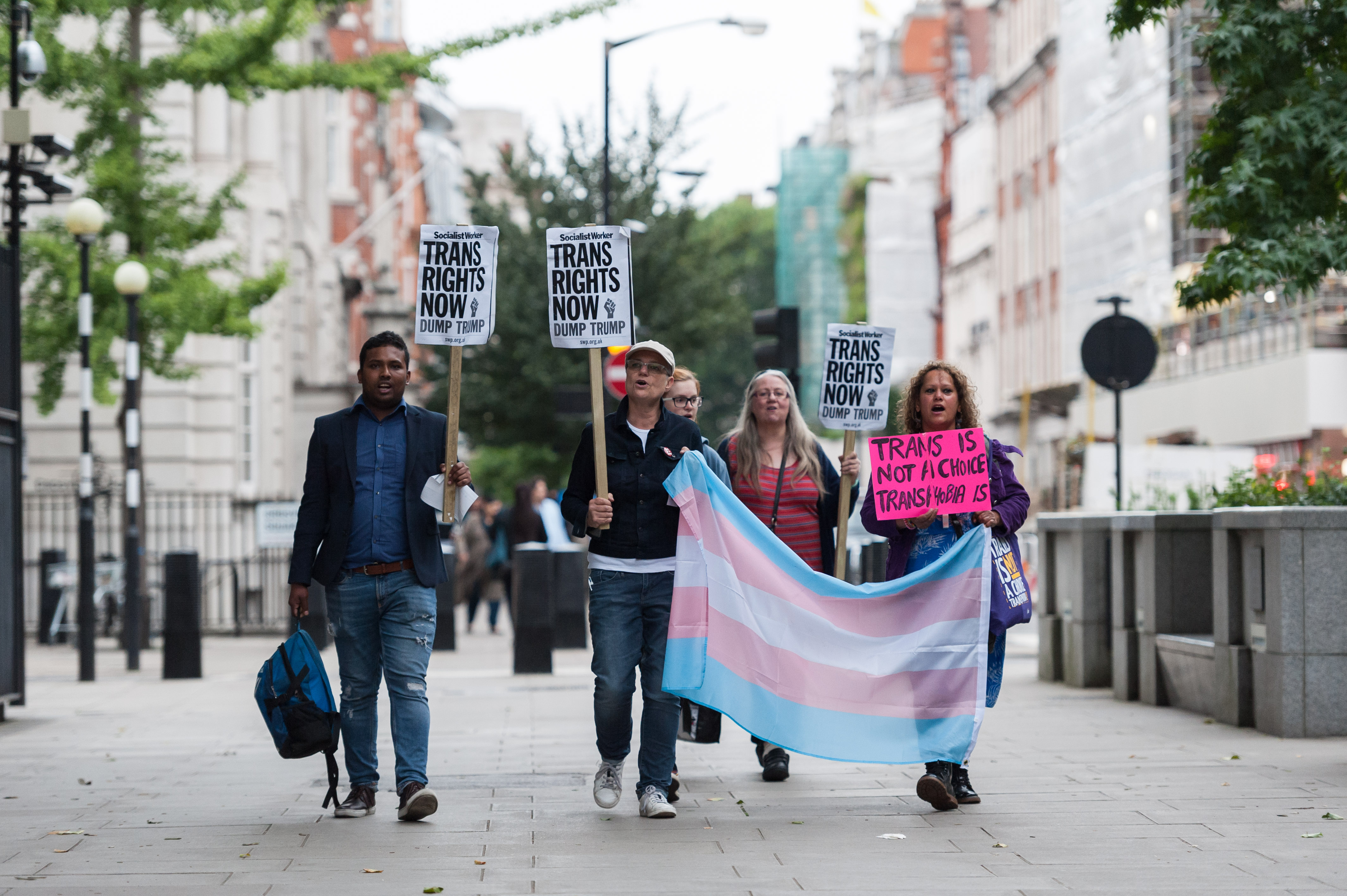 A group of demonstrators gather in front of the U.S. Embassy to protest against Donald Trump's latest announcement that transgender troops will not be allowed to serve in any capacity in the US military on July 28, 2017 in London, England.