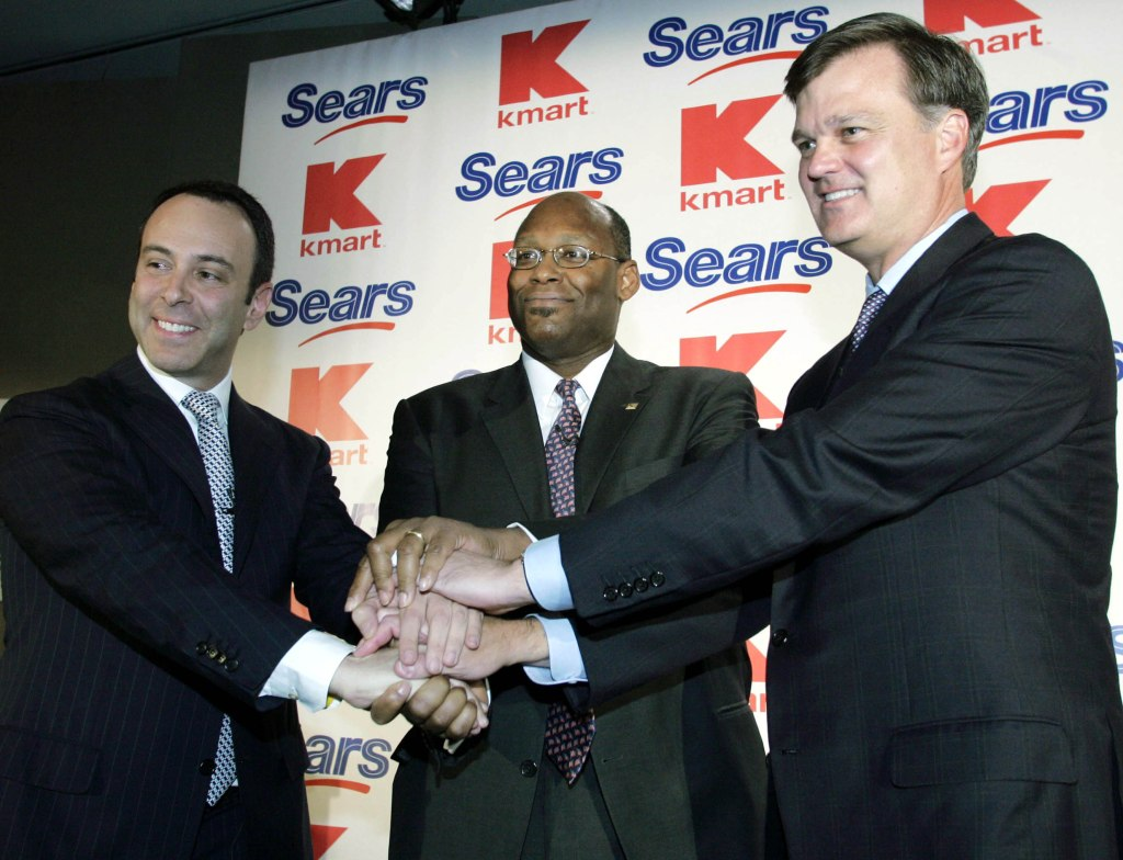 Handshake at Sears Kmart press conference in New York.