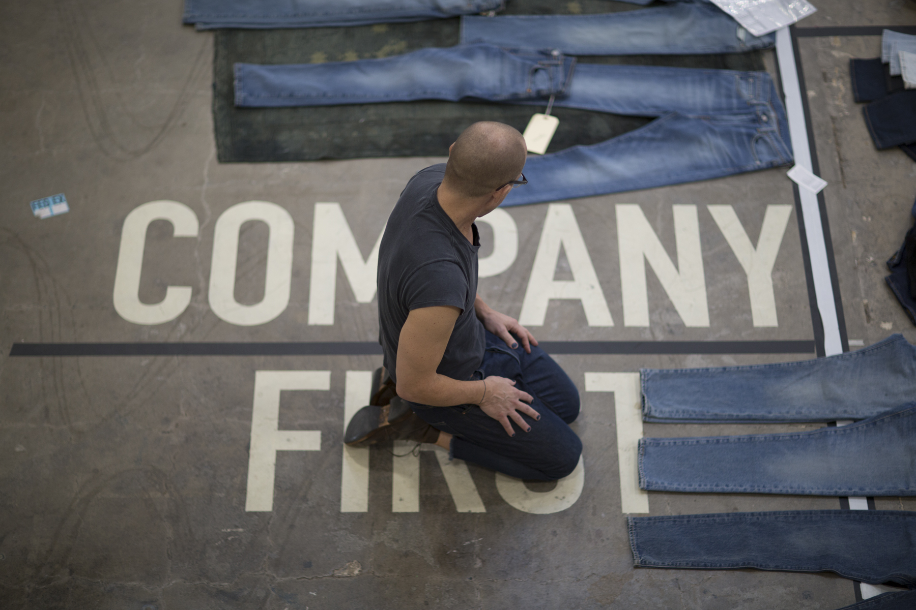 Bart Sights, VP of technical innovation at Levi Strauss, inspects jeans on the floor of his Eureka Innovation Lab in San Francisco