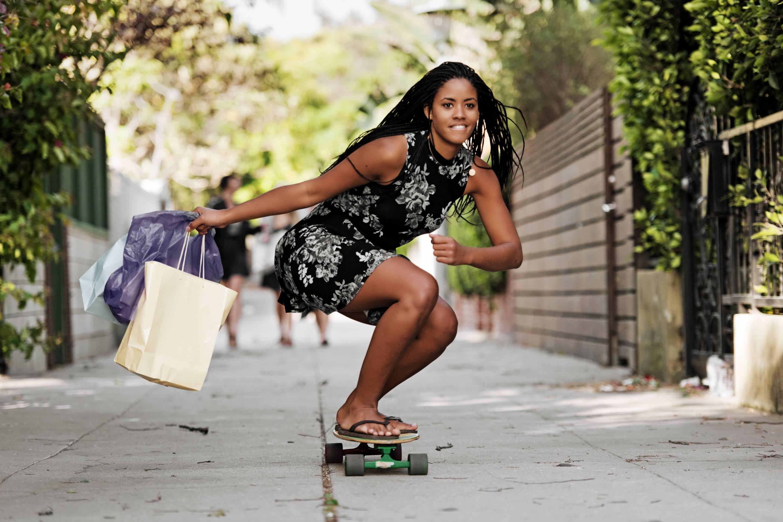 Young woman skating and shopping