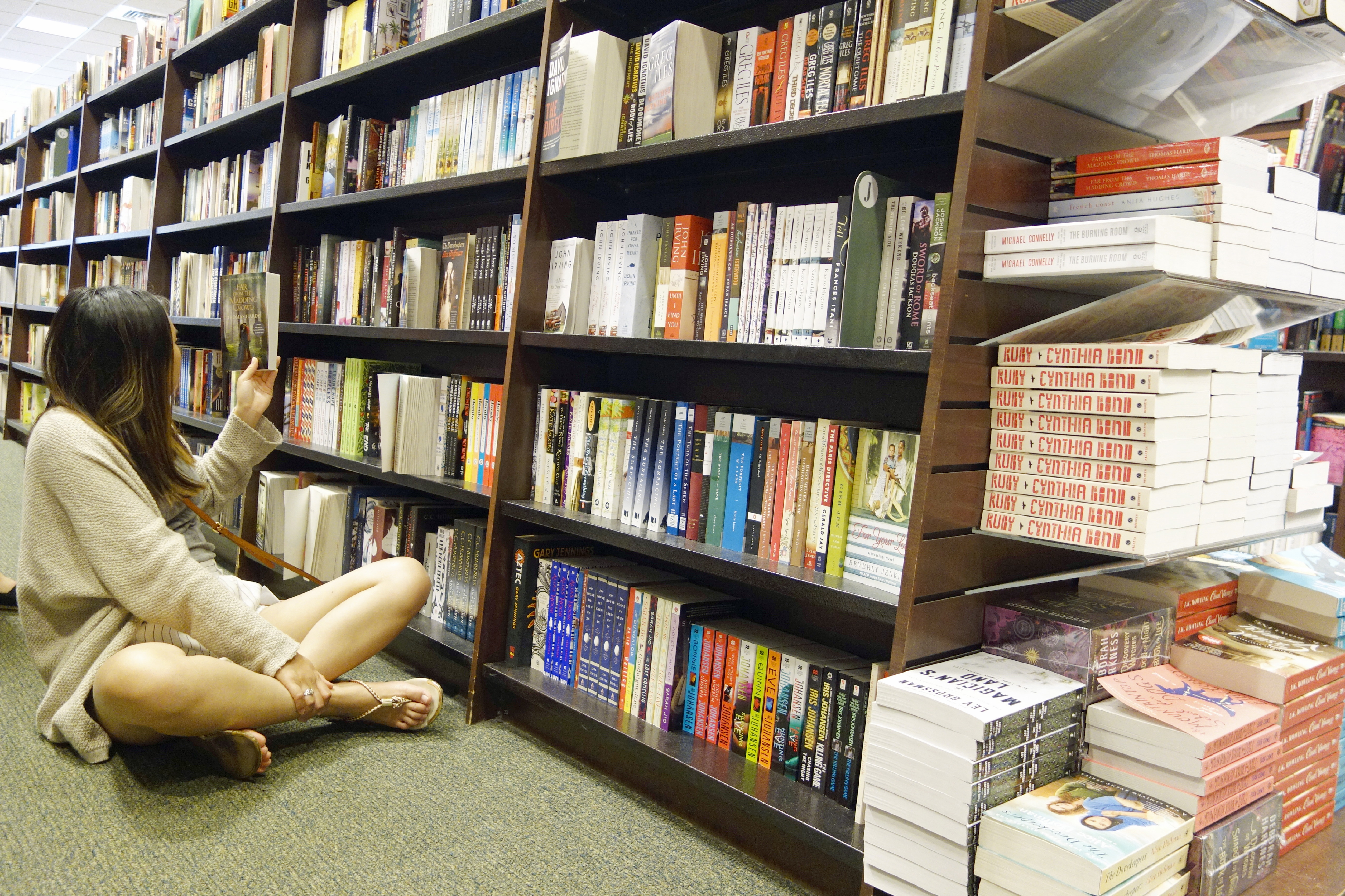 Woman Looking at Books in Bookstore, Boston, Massachusetts, United States
