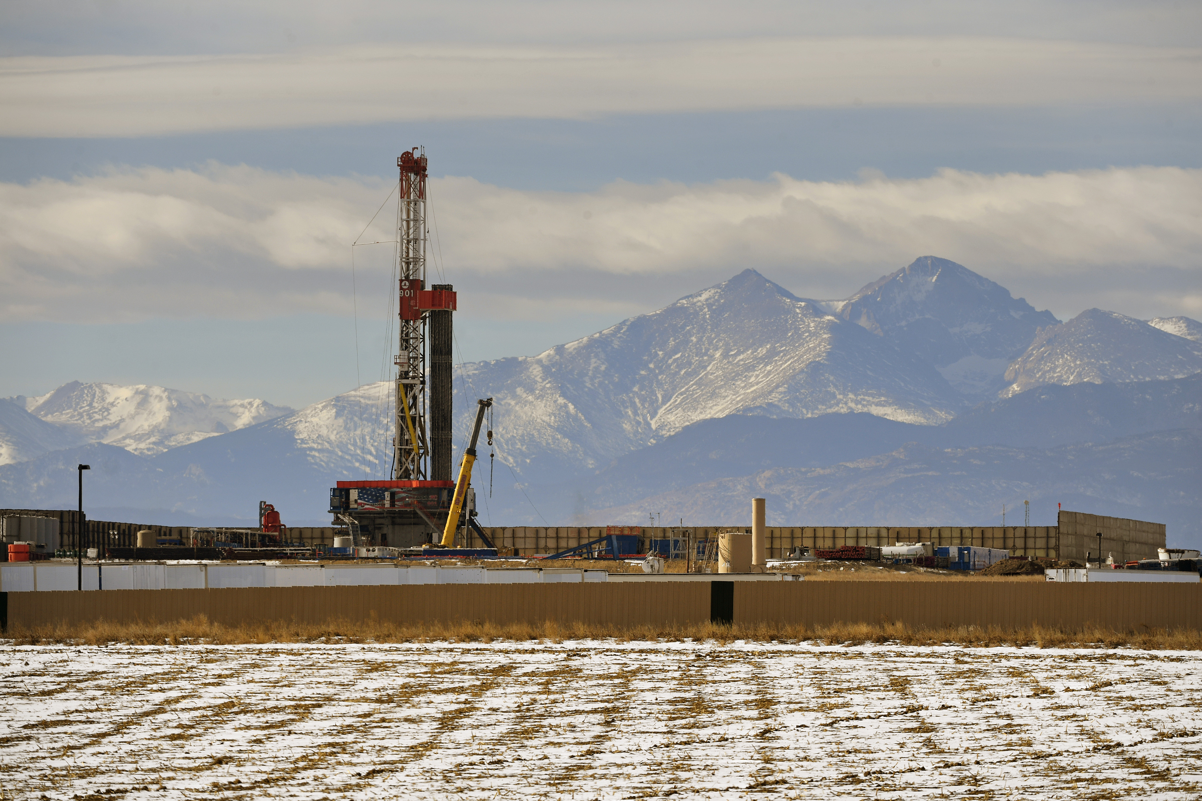 A large fracking operation with mountains looming in the background on December 28, 2017 in Loveland, Colorado.