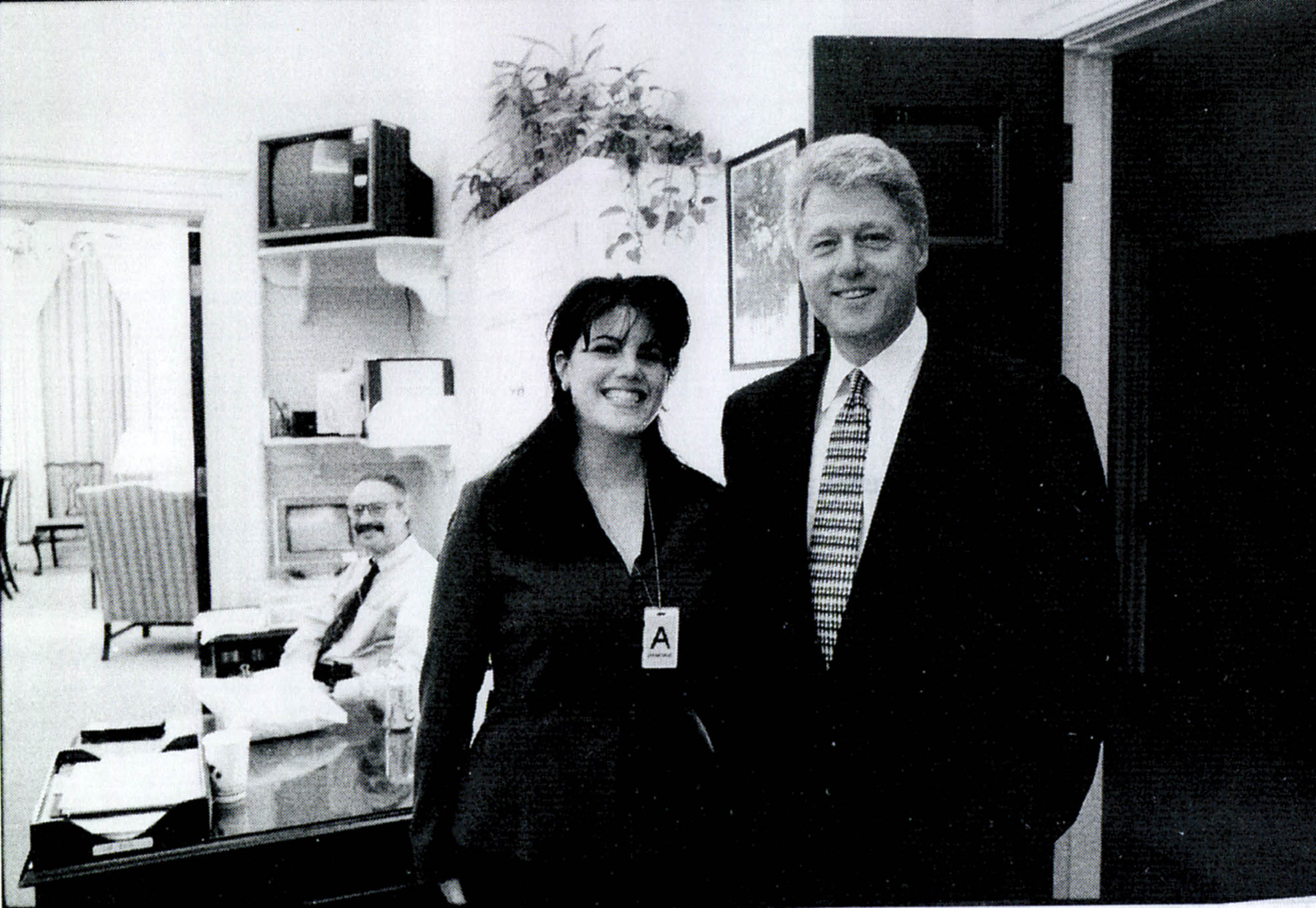 Monica Lewinsky stands next to President Bill Clinton in 1998. The two had an affair.