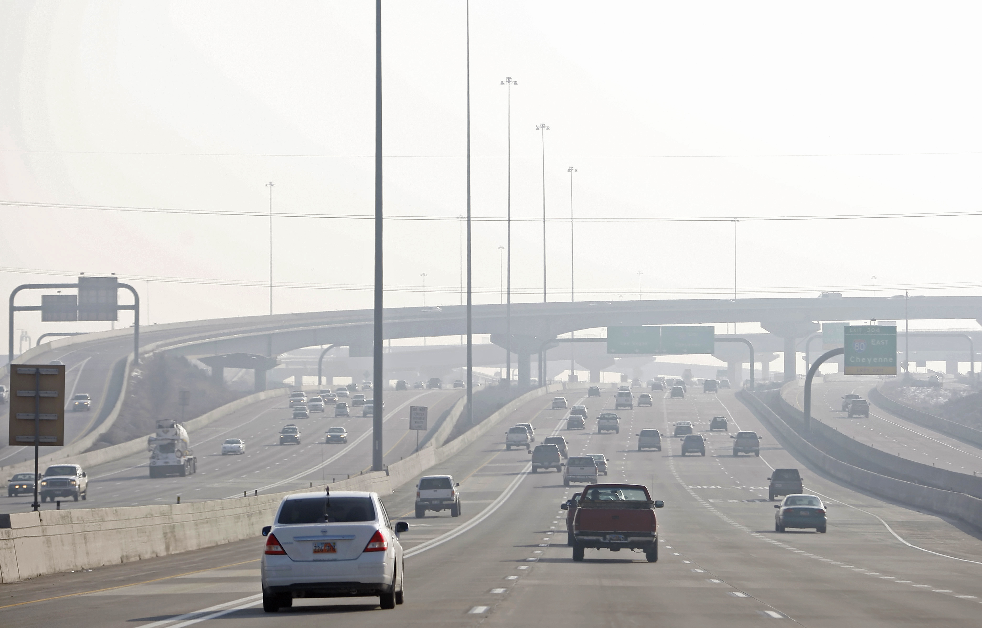 Cars on a highway in heavy smog south of downtown Salt Lake City in Utah, U.S., on Monday, Jan. 11, 2010.