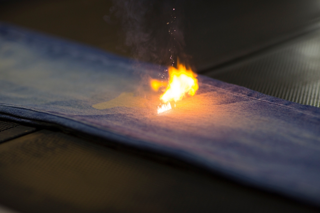 A pair of jeans undergoing laser finishing at Levi's Eureka Innovation Lab in San Francisco.