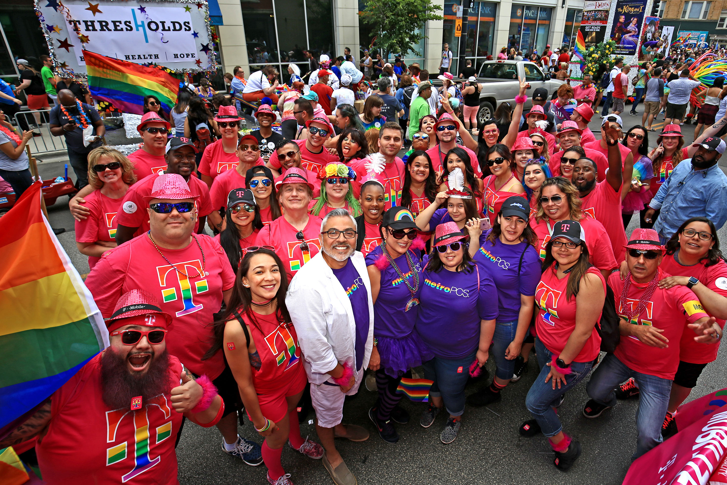 T-Mobile employees, friends and family during Chicago Pride on June 25, 2017. T-Mobile offered spousal benefits and insurance coverage for gay couples even when t wasn't legally required to, and is a major sponsor at several Pride events.