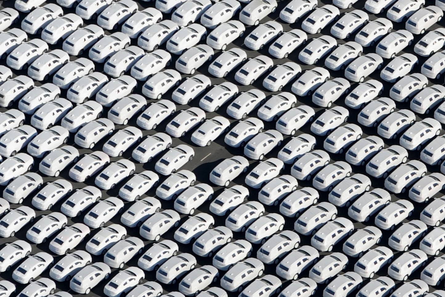 New cars from German automaker Volkswagen stand ready for shipping next to the VW plant in Emden, northwestern Germany, on Sept. 30, 2015.