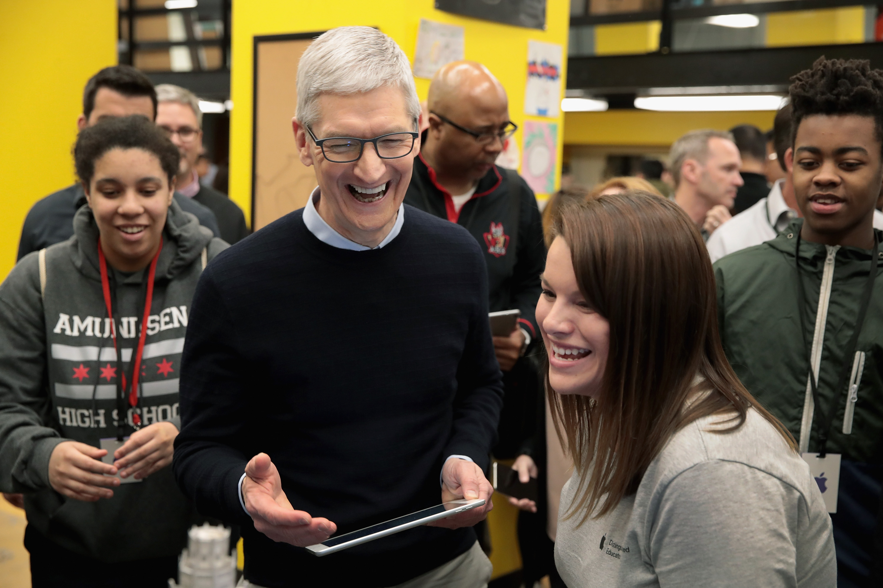 Apple CEO Tim Cook gets at an event to introduce the new 9.7-inch Apple iPad at Lane Tech College Prep High School in Chicago, Illinois.