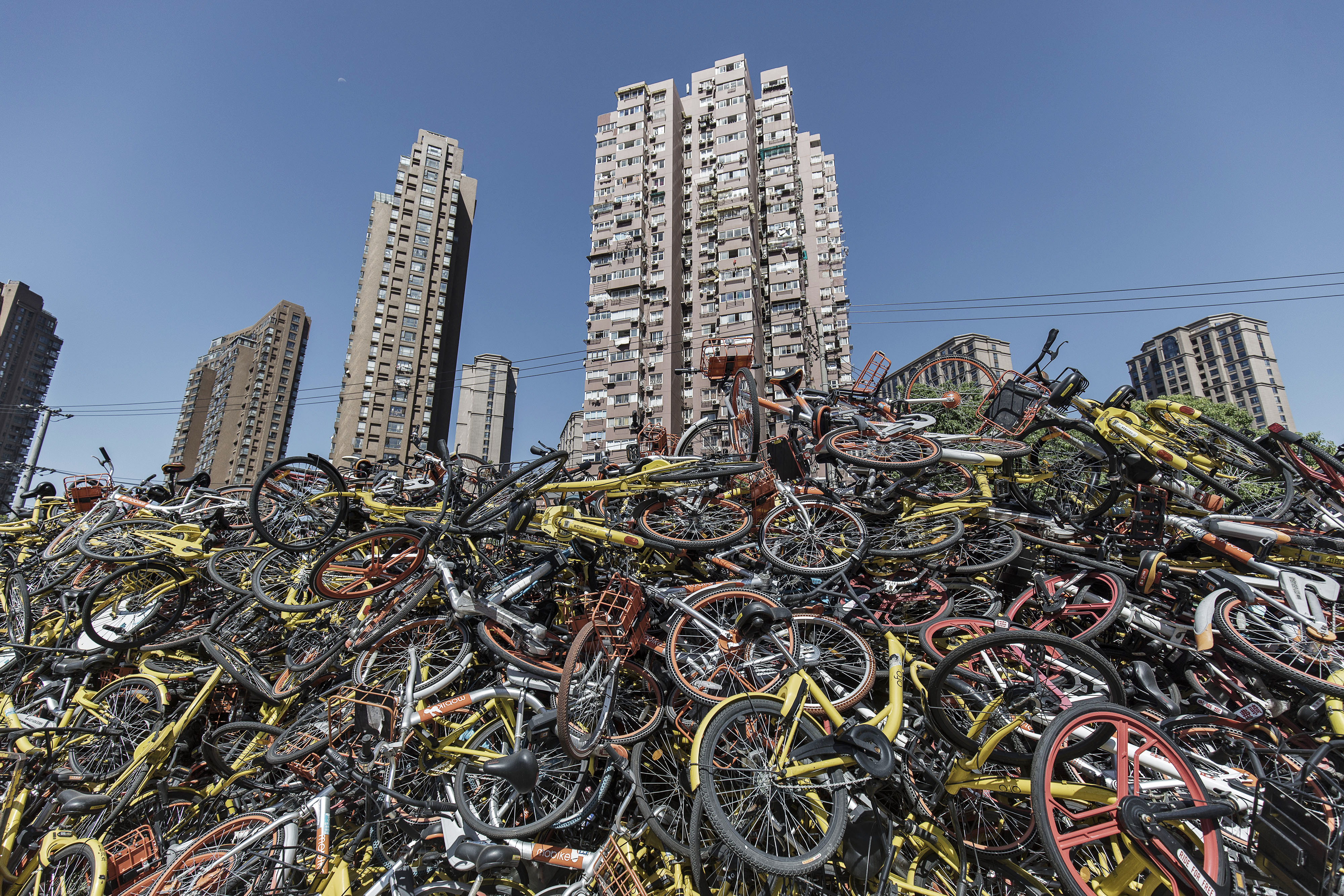 Ride-sharing bicycles sit in a pile in Shanghai, China, on Thursday, Sept. 12, 2017.