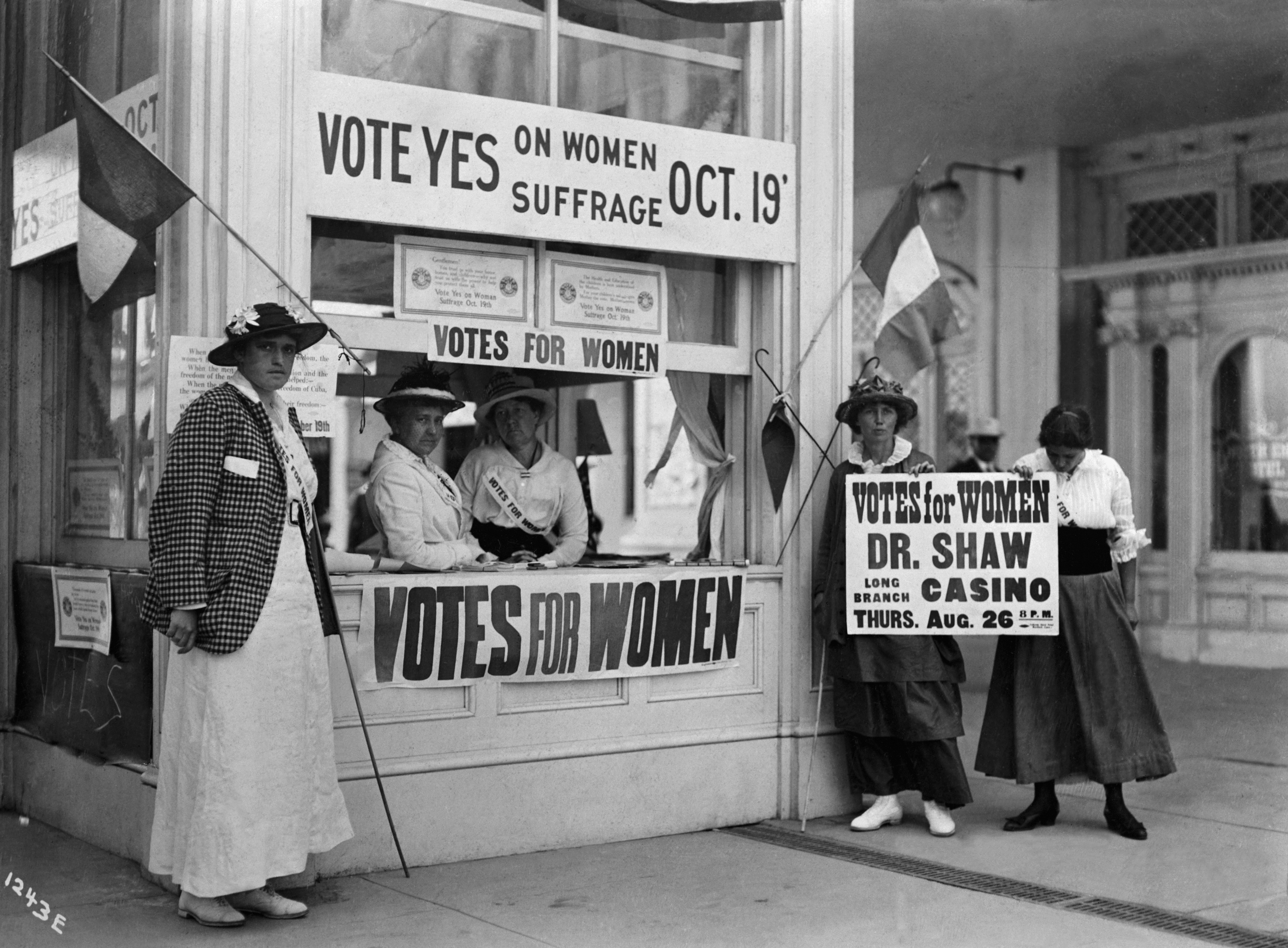 Activists at Women's Suffrage Booth