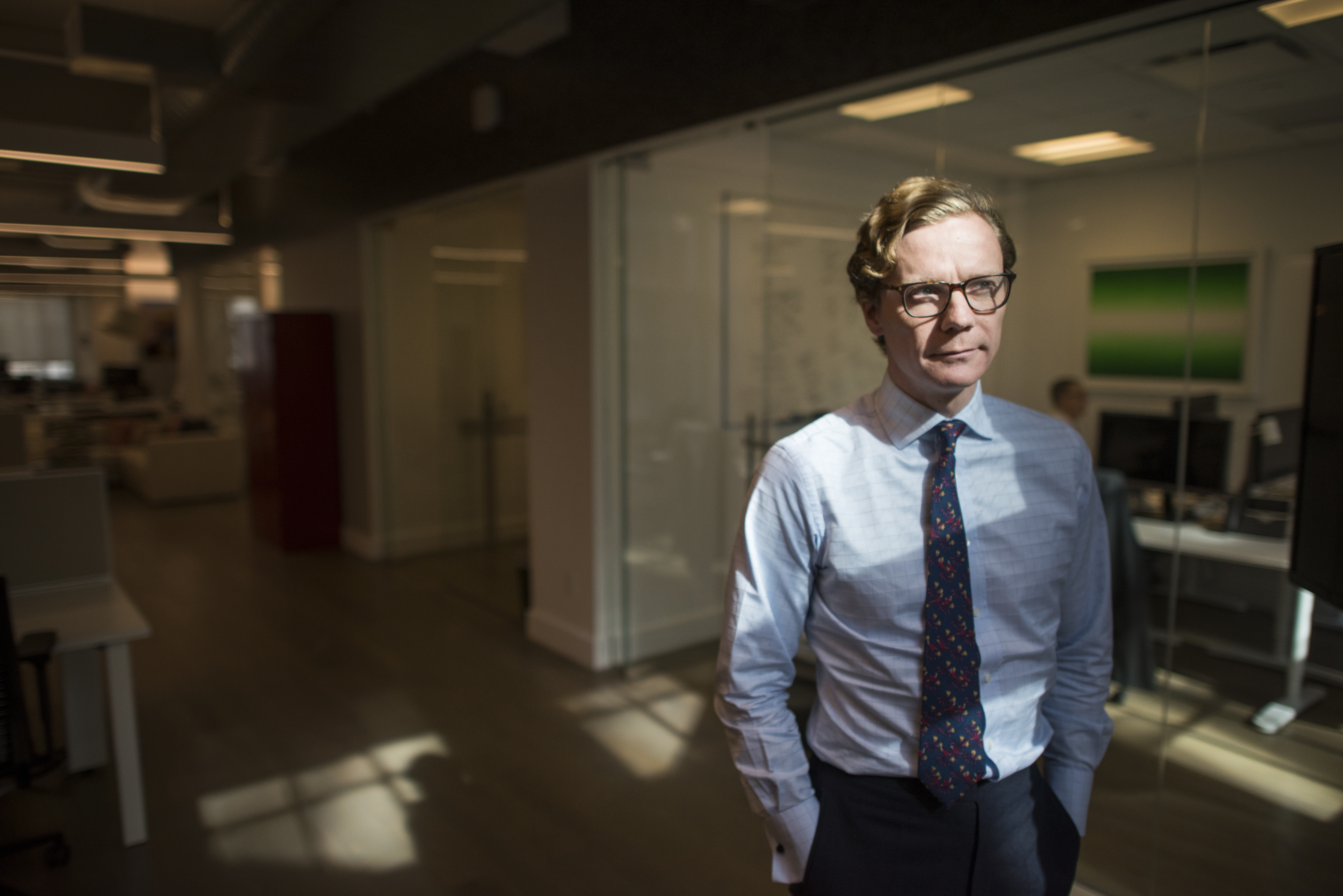 Cambridge Analytica CEO Alexander Nix in an office setting