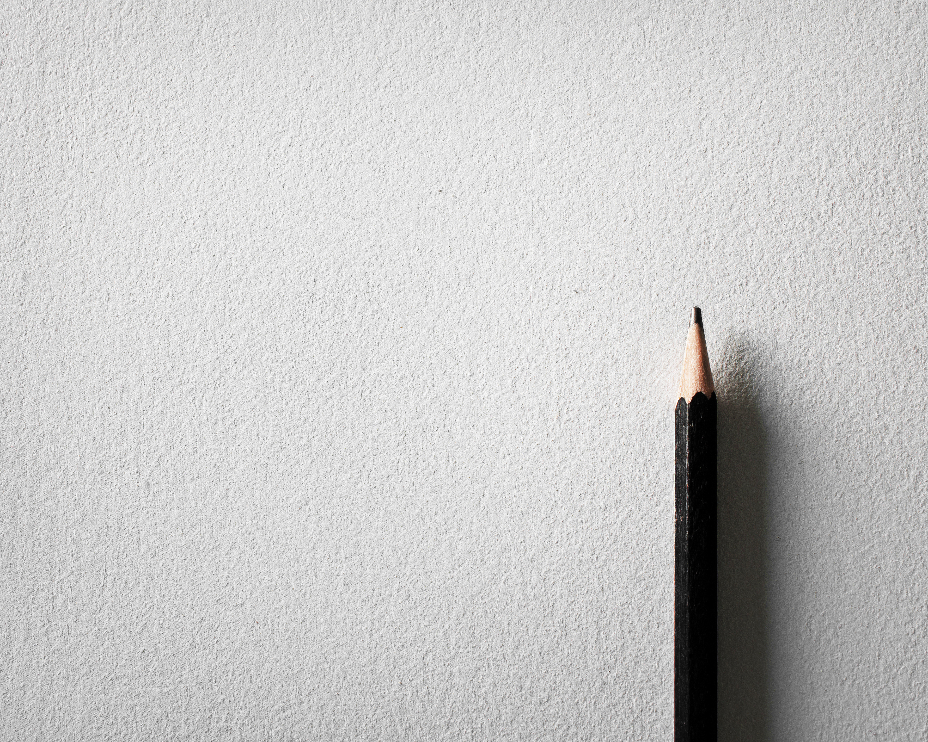 Close-Up Of Pencils On Paper