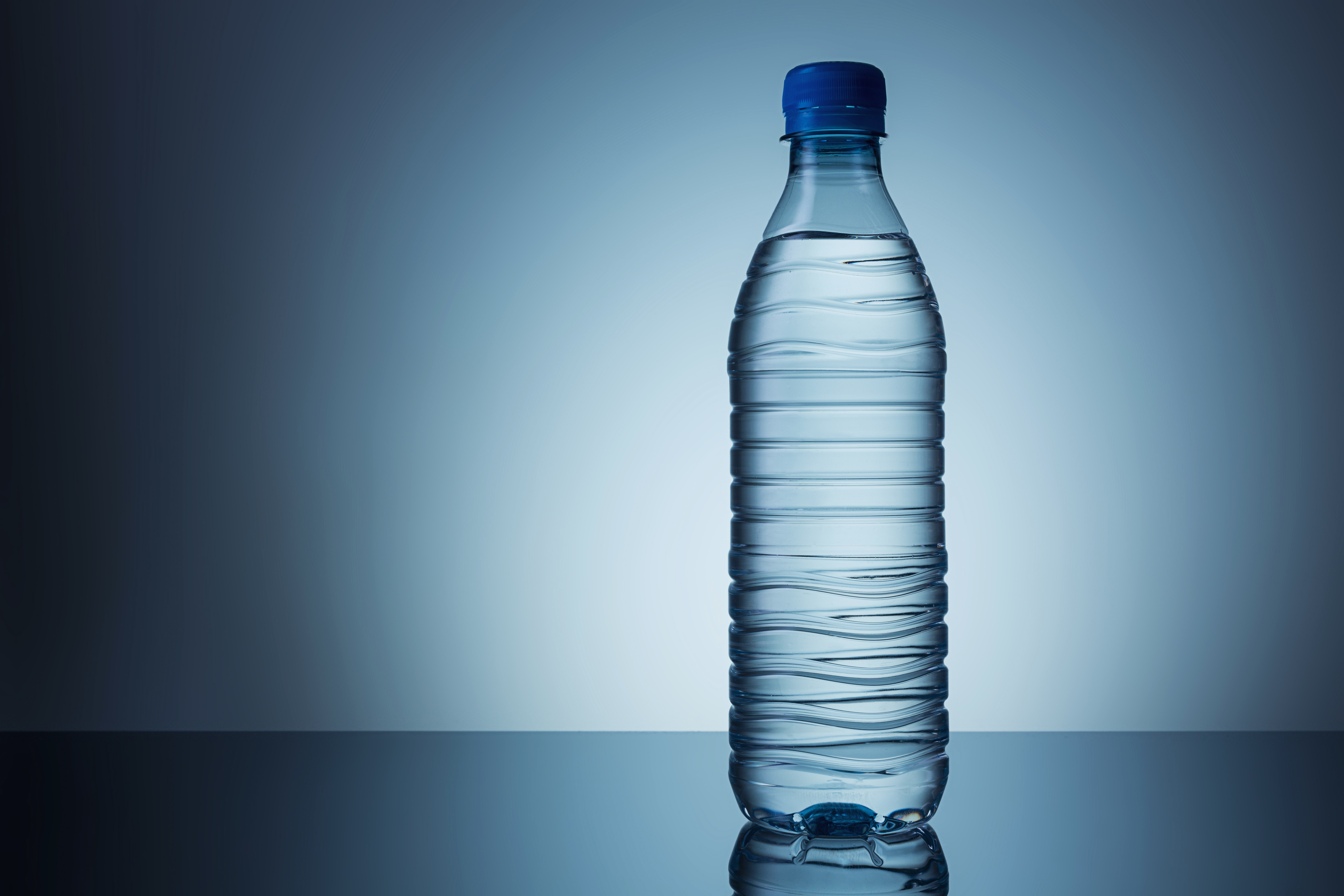 Close-Up Of Water Bottle Against Gray Background