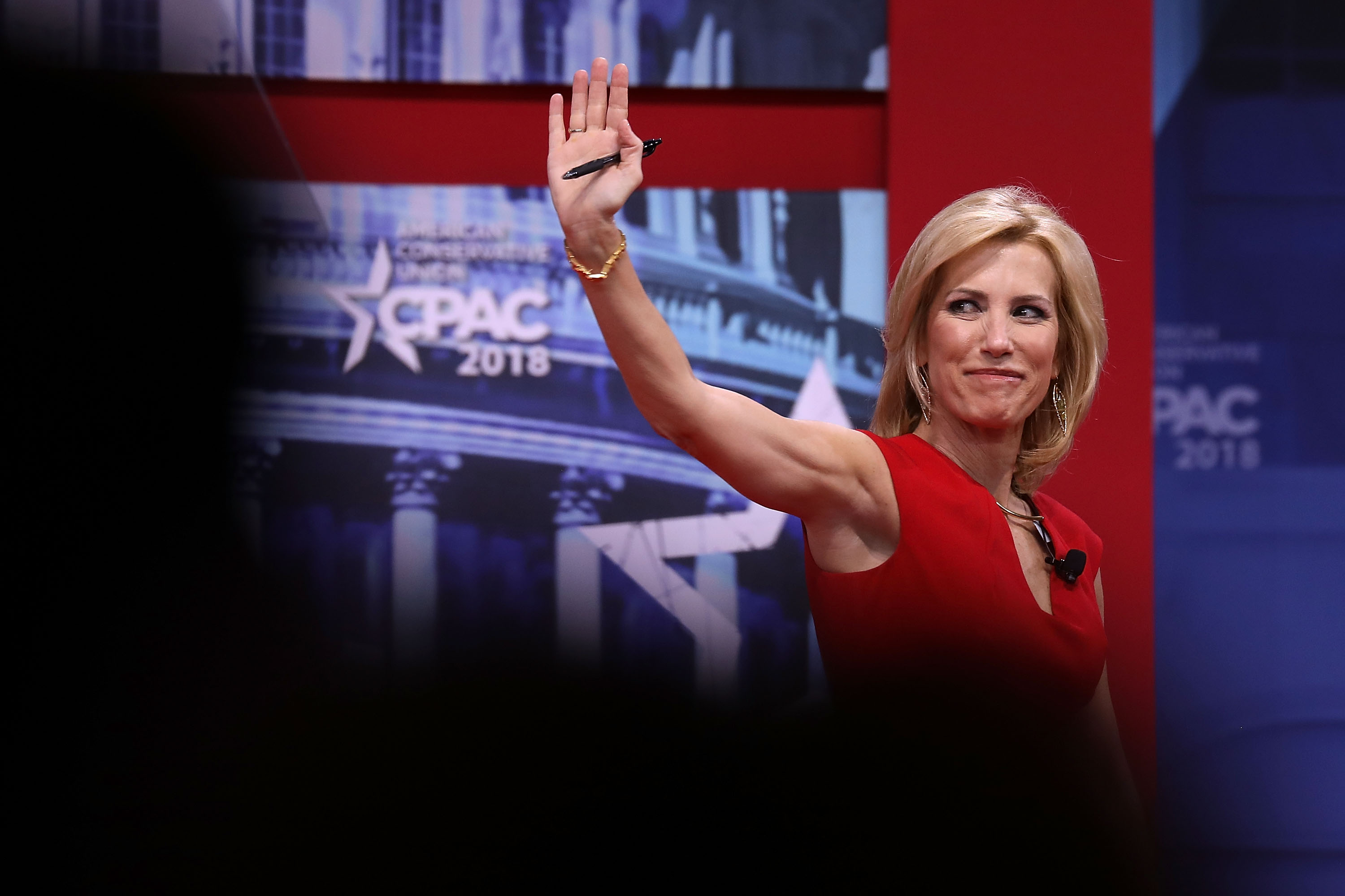 Laura Ingraham, Fox News host, waves to crowd from CPAC stage