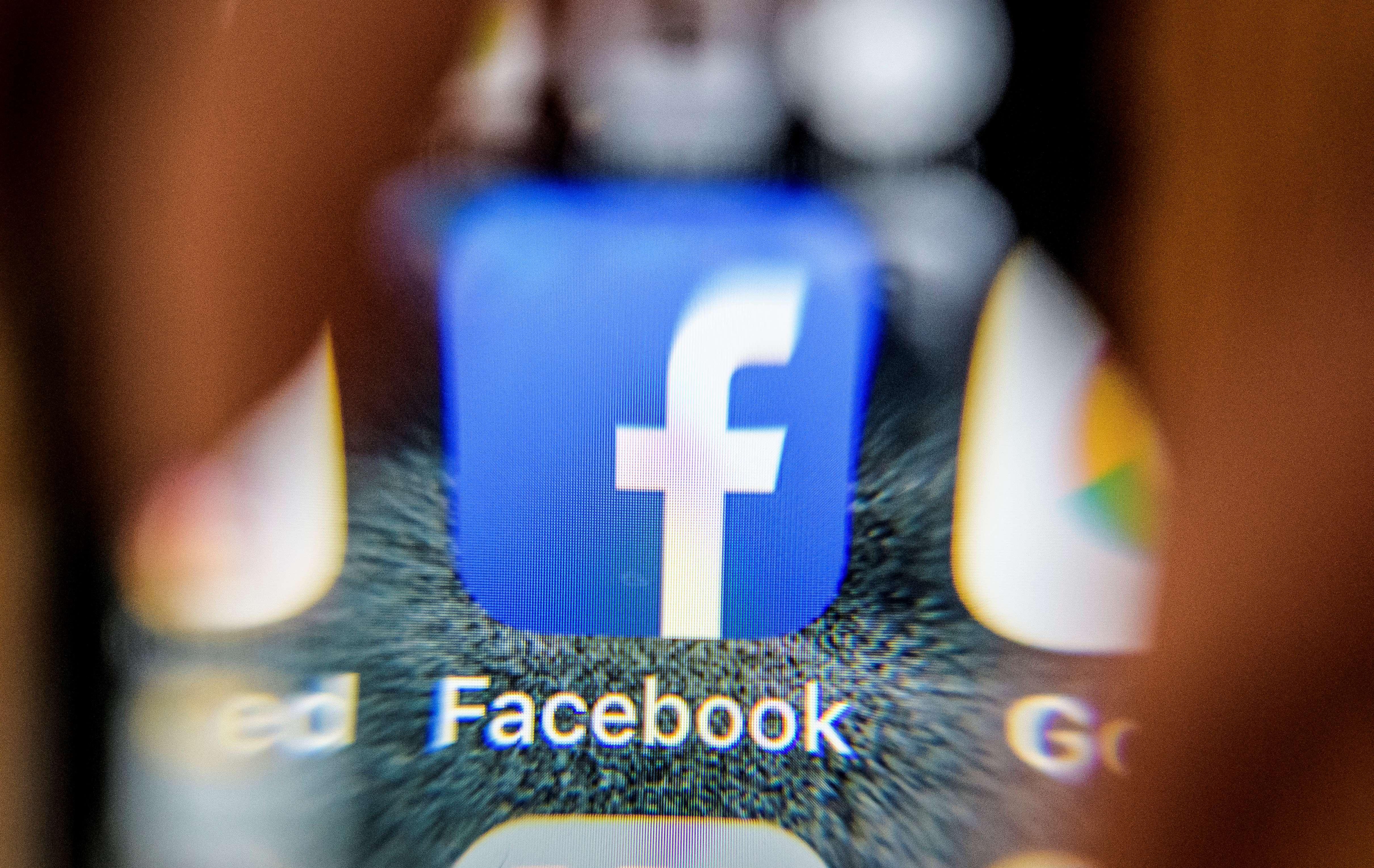 Facebook logo on smartphone
