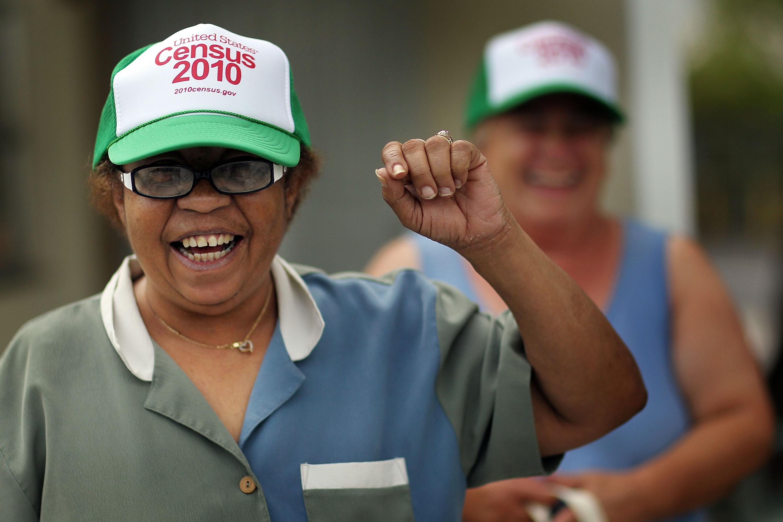Woman wears Census 2010 hat