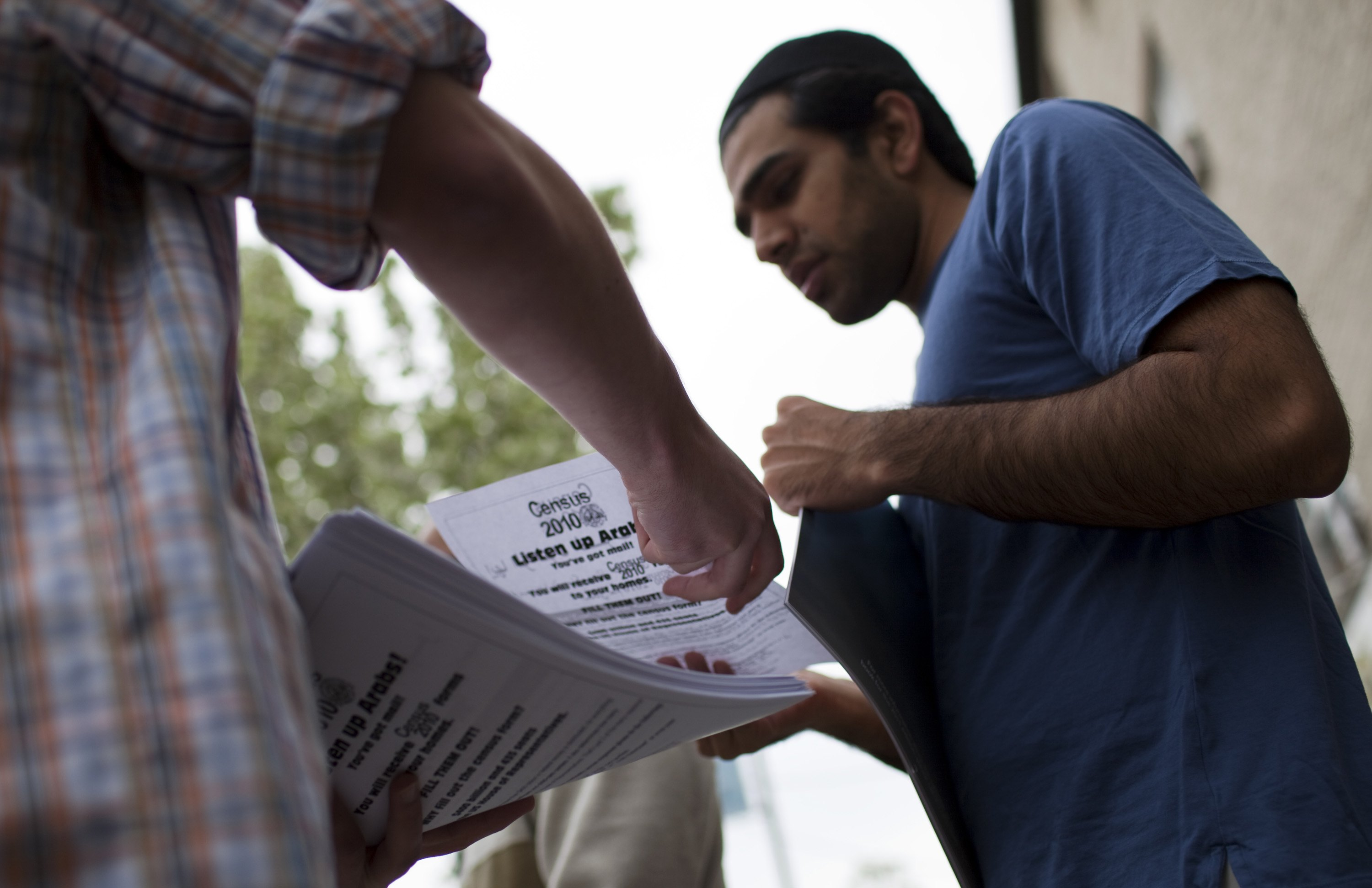 Man holds census forms amid outreach to Arab Americans