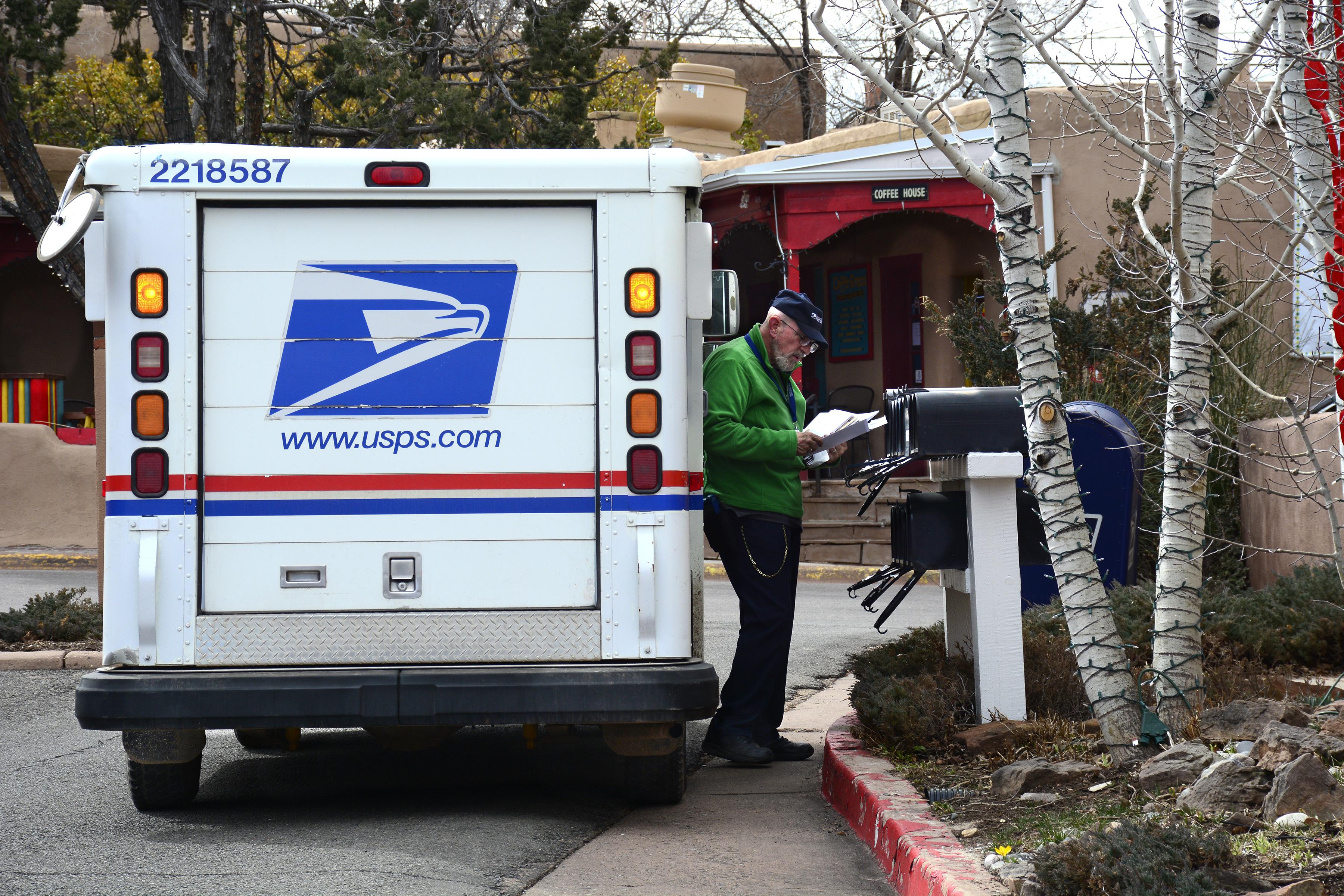 USPS worker delivering mail