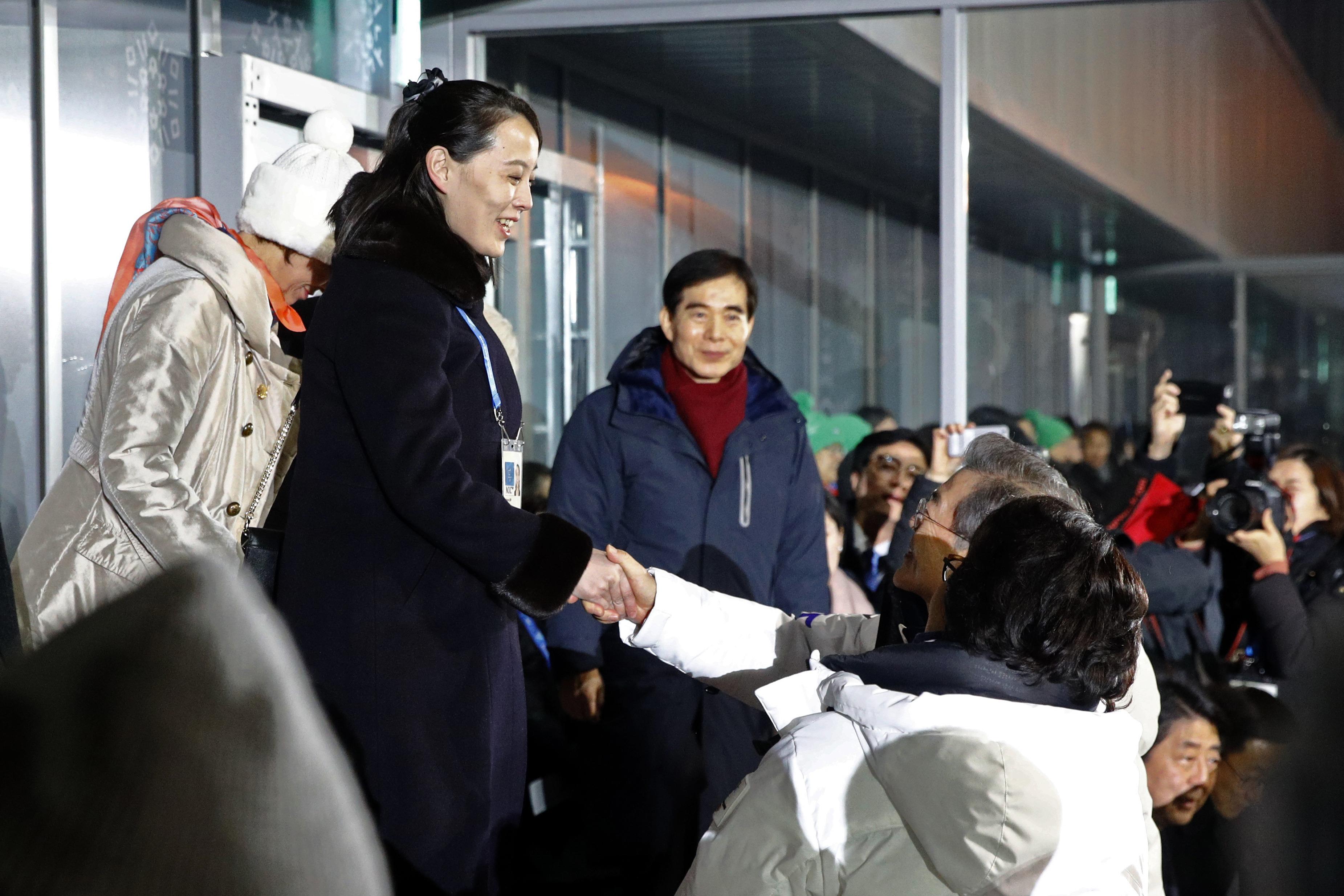 Kim Yo Jong, sister of North Korean leader Kim Jong Un, shakes hands with South Korean President Moon Jae-in.