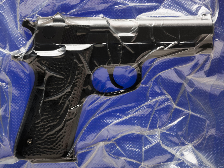 Shrink wrapped hand gun