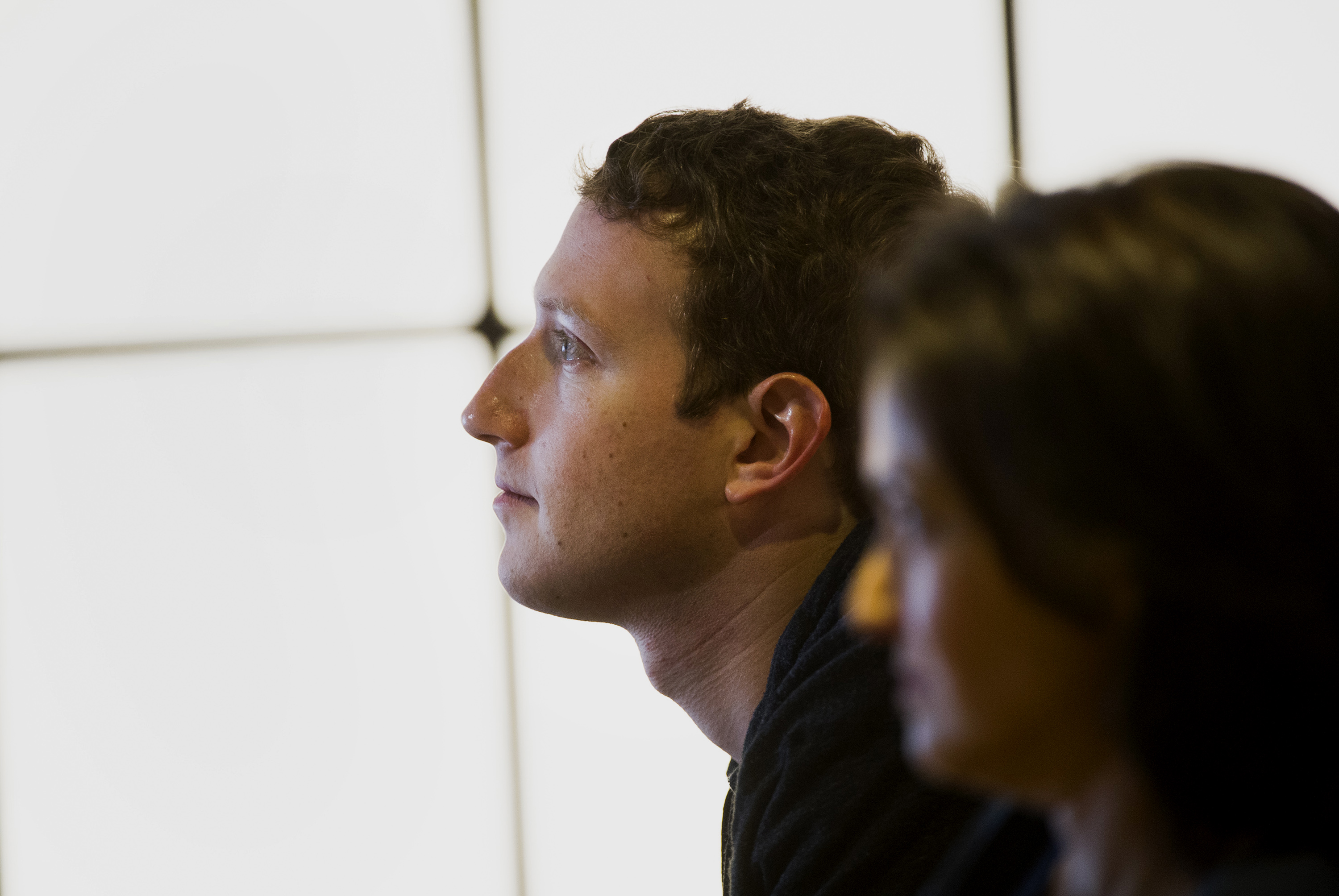 Facebook CEO Mark Zuckerberg and COO Sheryl Sandberg watch a presentation at the company's headquarters in Menlo Park, California.